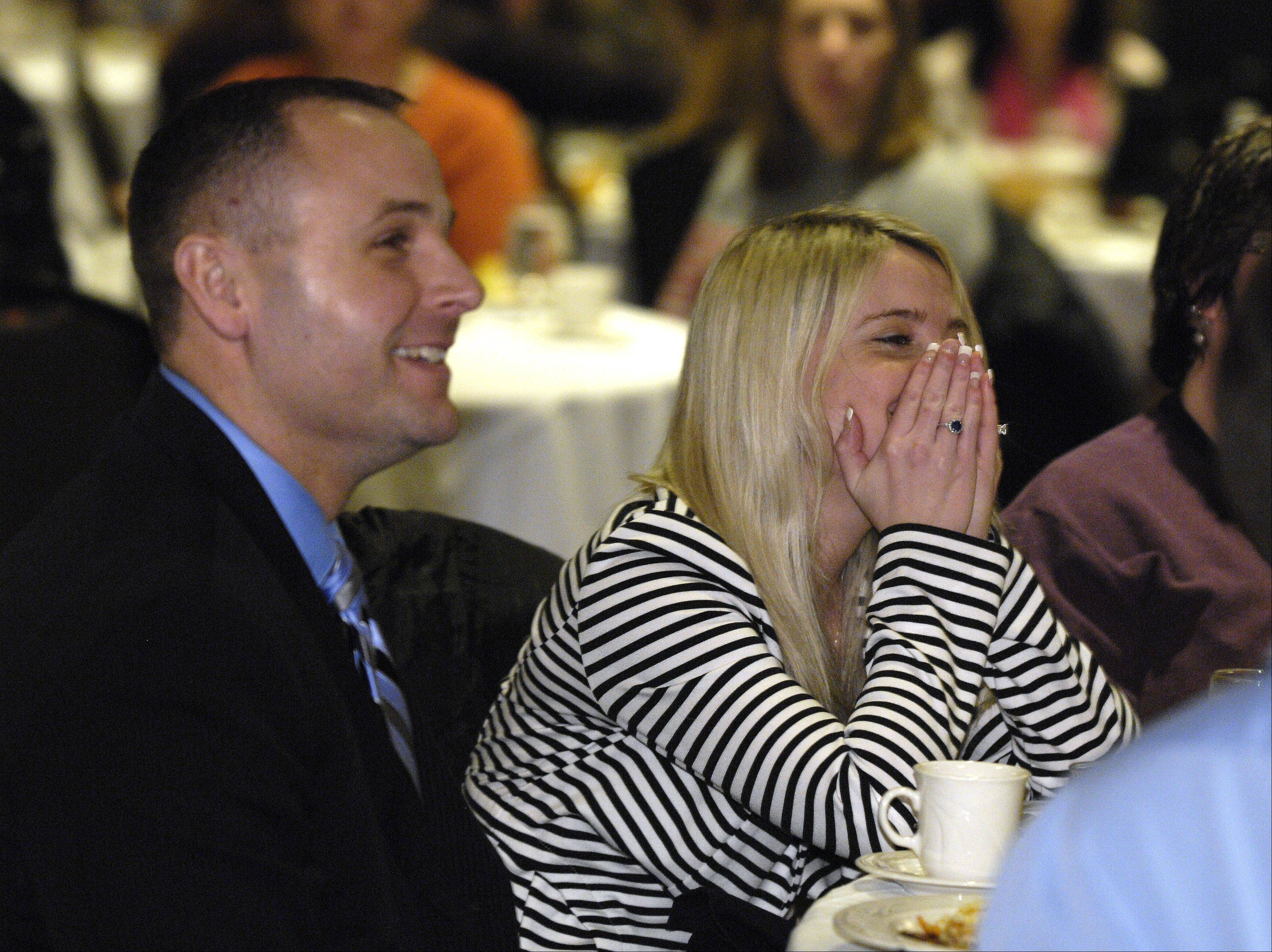 With Dixon Police Chief Dan Langloss at her side, Schaumburg native Erin Merryn reacts to receiving the �Champion for Children Award� from the Children�s Advocacy Center on Monday during a luncheon at Indian Lakes Resort in Bloomingdale. Merryn helped pass �Erin�s Law,� which went into effect earlier this year and mandates sexual abuse awareness programs in all Illinois schools.