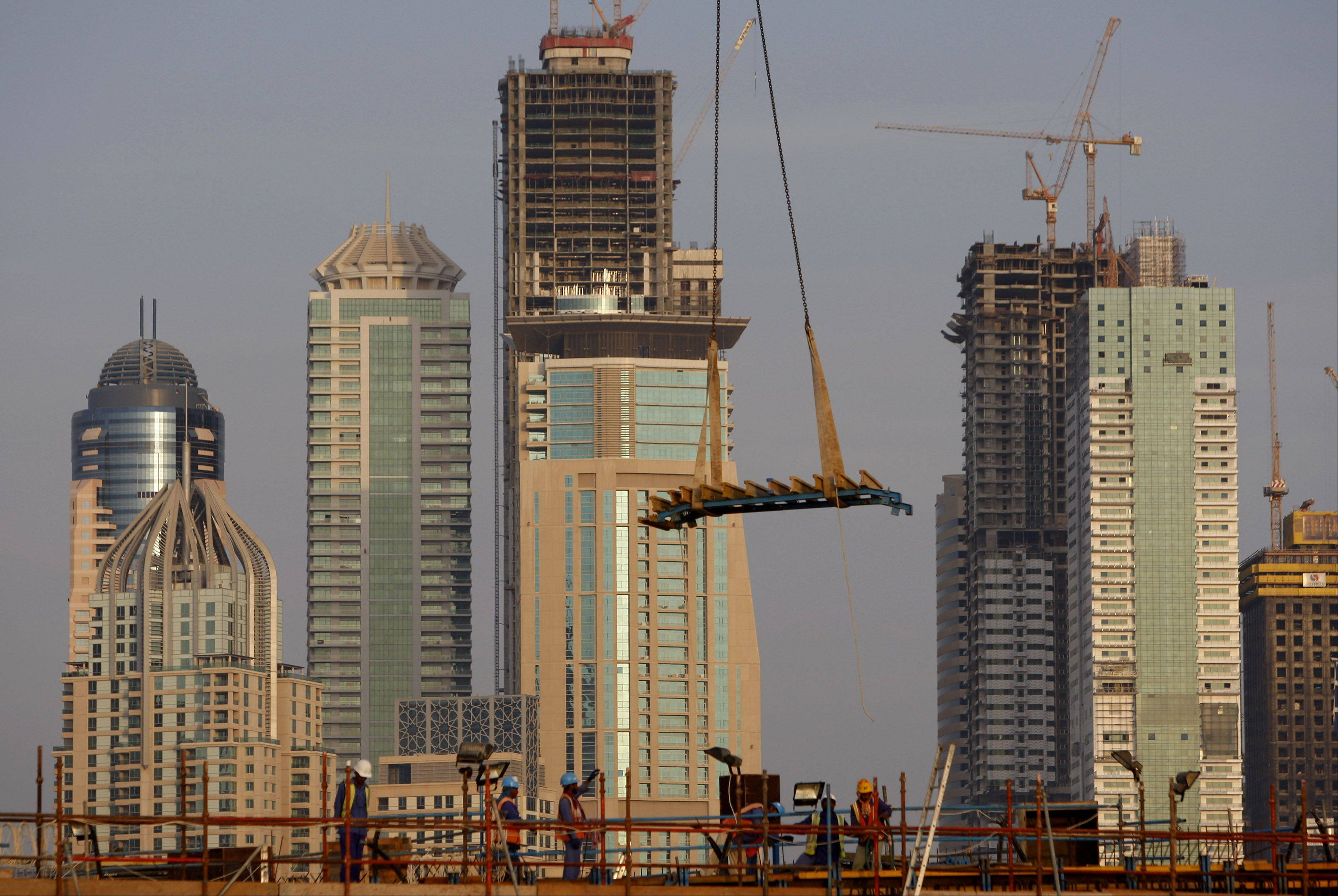 "Dubai faces a ""pivotal year"" in 2014 as the emirate tackles $20 billion of debt amid an unclear legal framework for restructurings and uncertain support from its richer neighbor, Moody's Investors Service said."
