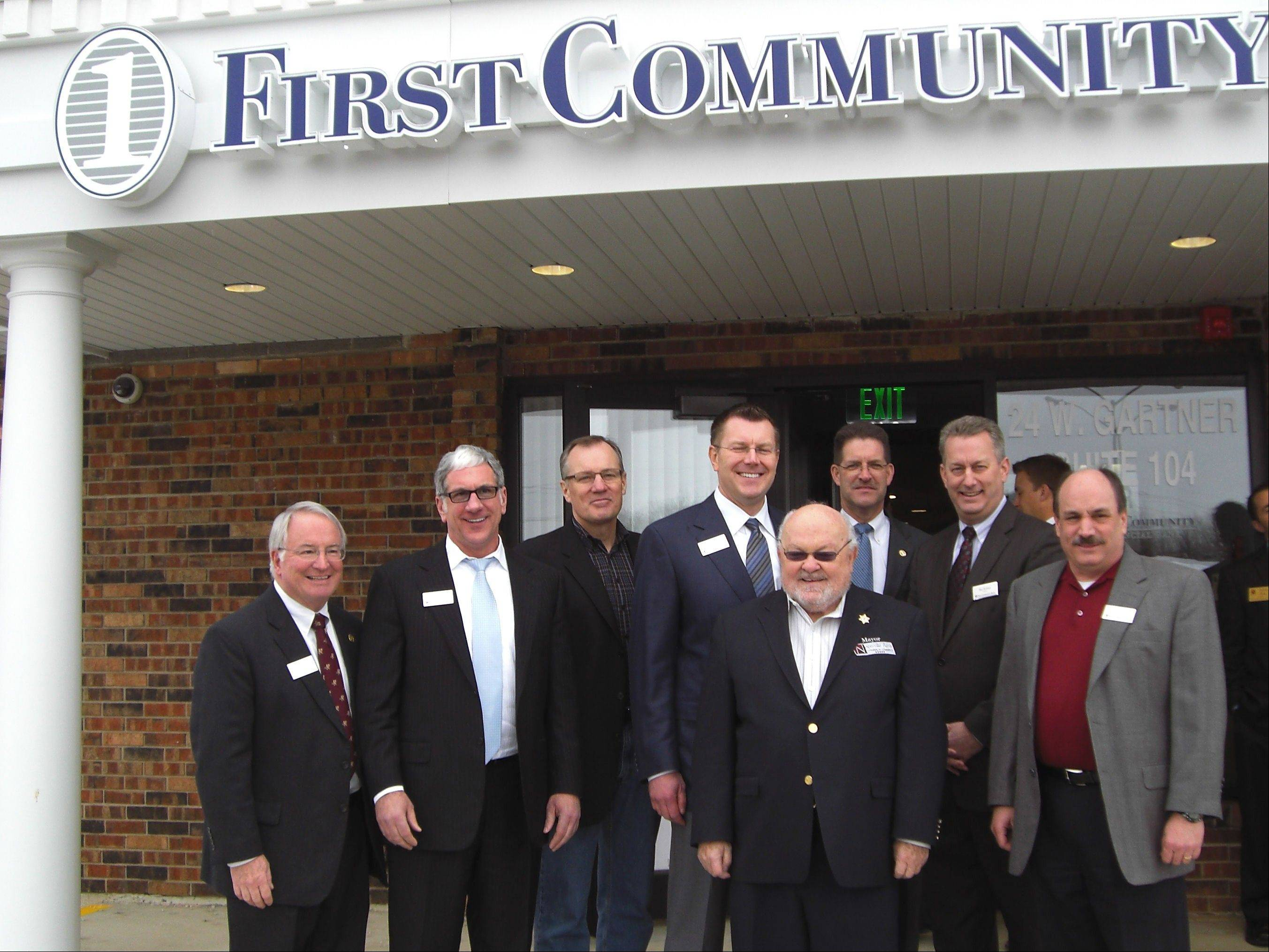Pat Benton, market president First Community Bank -- Naperville, from left, board members John Freiburger, Dan Casey, and Scott Wehril, Naperville Mayor A. George Pradel, Steven Randich, president of First Community Bank of Joliet, and board members Ray Kinney and Kevin Gensler. .