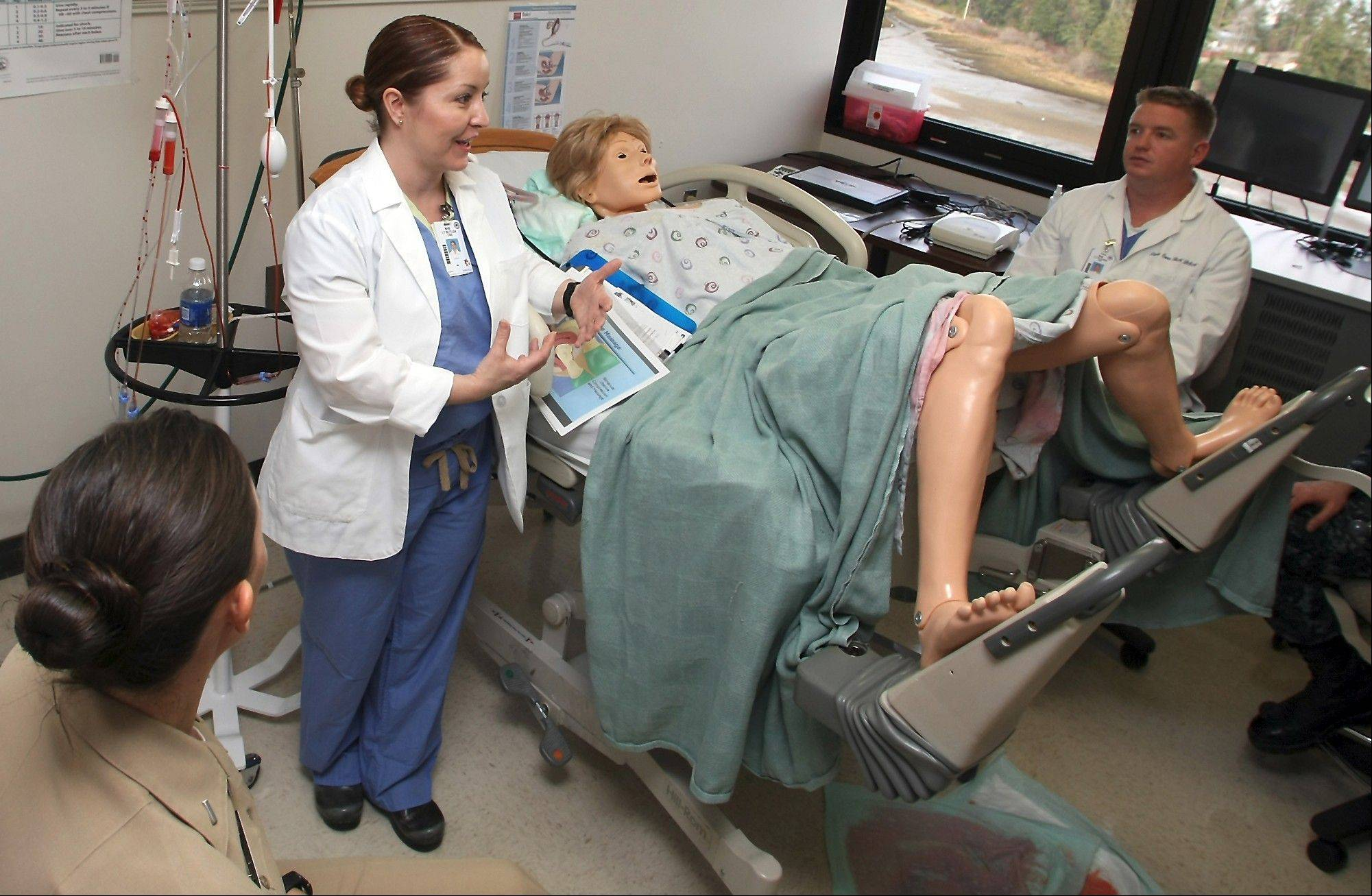 "Lt. Patty Butler works with the patient simulator named ""Anne"" as she goes over an OB-GYN scenario during a nurse orientation at Naval Hospital Bremerton in Bremerton, Wash."