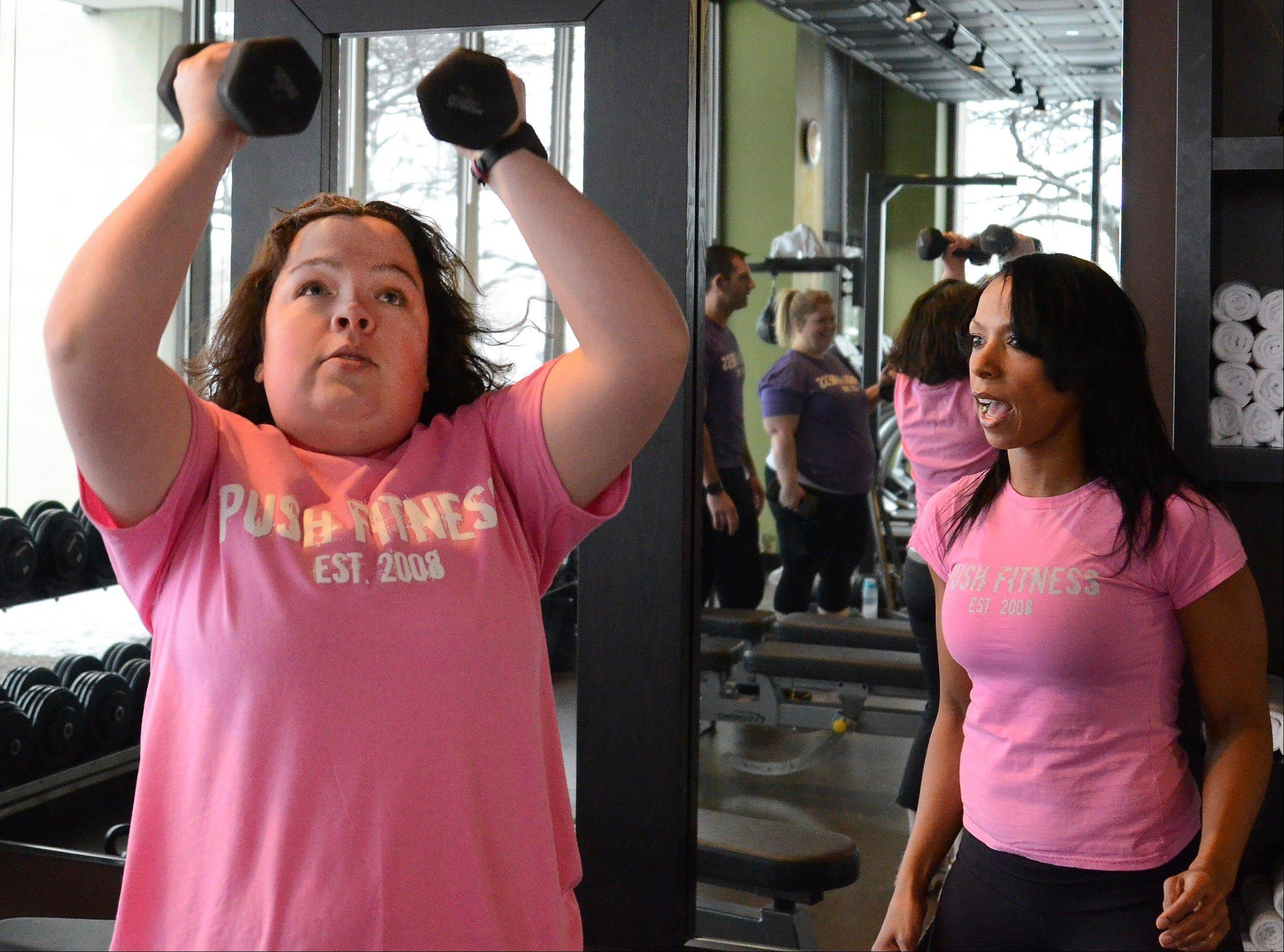 Trainer Michelle Amsden works with Fittest Loser contestant Karen Castillo.