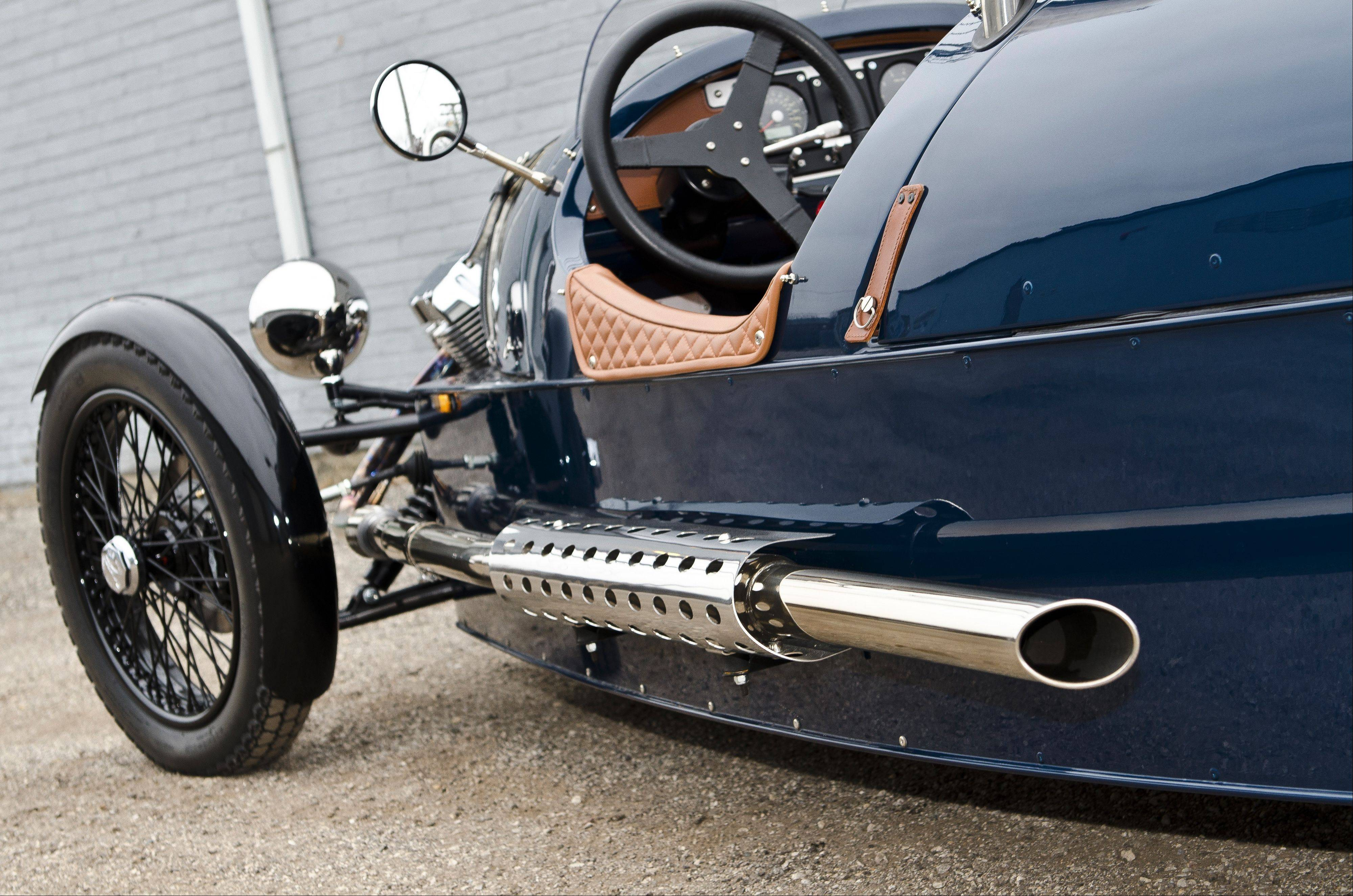 Dual exhausts extend down the sides of the three-wheeled Morgan.