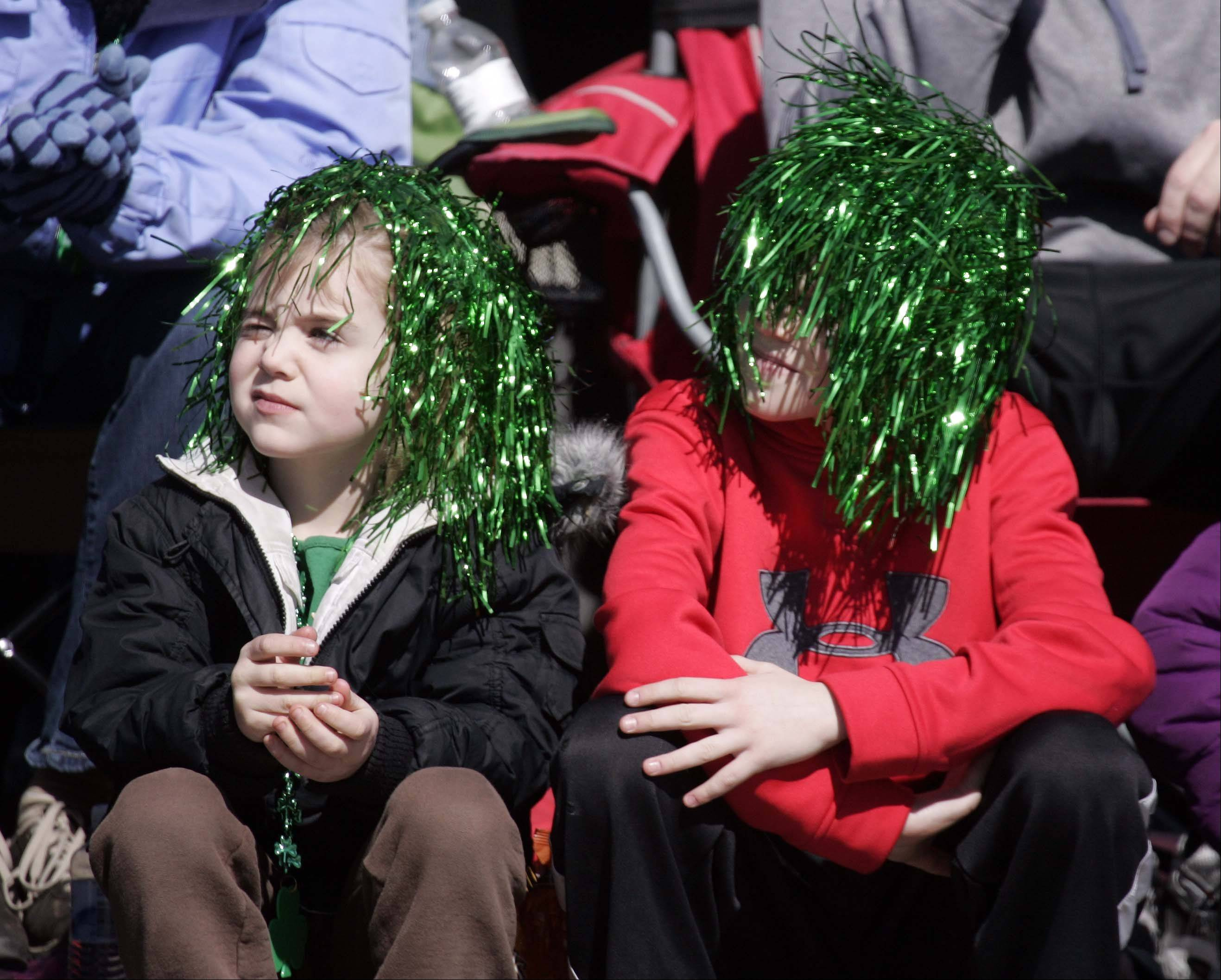 Donning some green hair, Haley Nelson, 5, of South Elgin, left and her brother Colin, 10, get a close-up view of the St. Patrick's Day parade last year in St. Charles.
