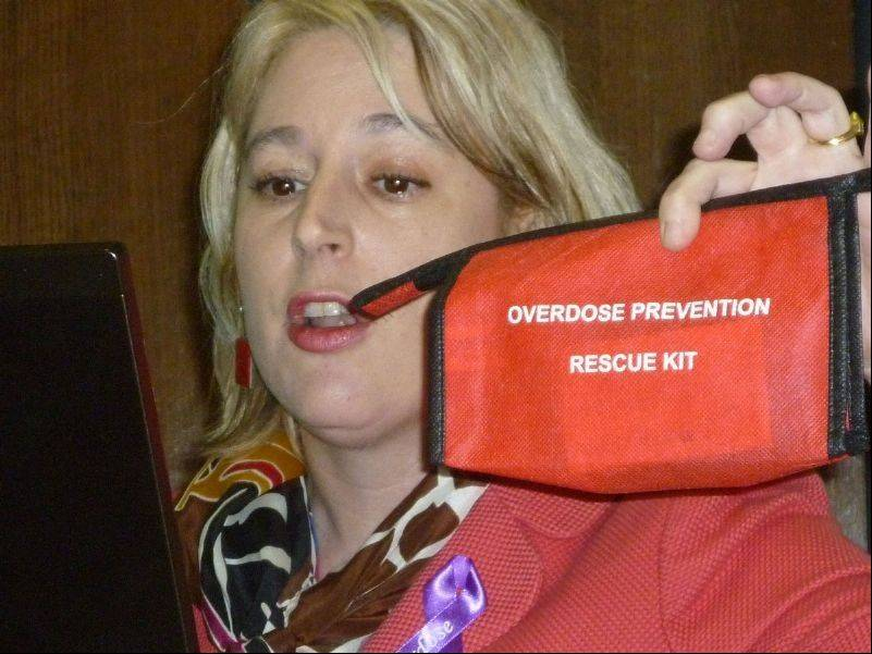 Kathie Kane-Willis holds up an Overdose Prevention Rescue Kit during an emergency heroin summit held over the weekend.