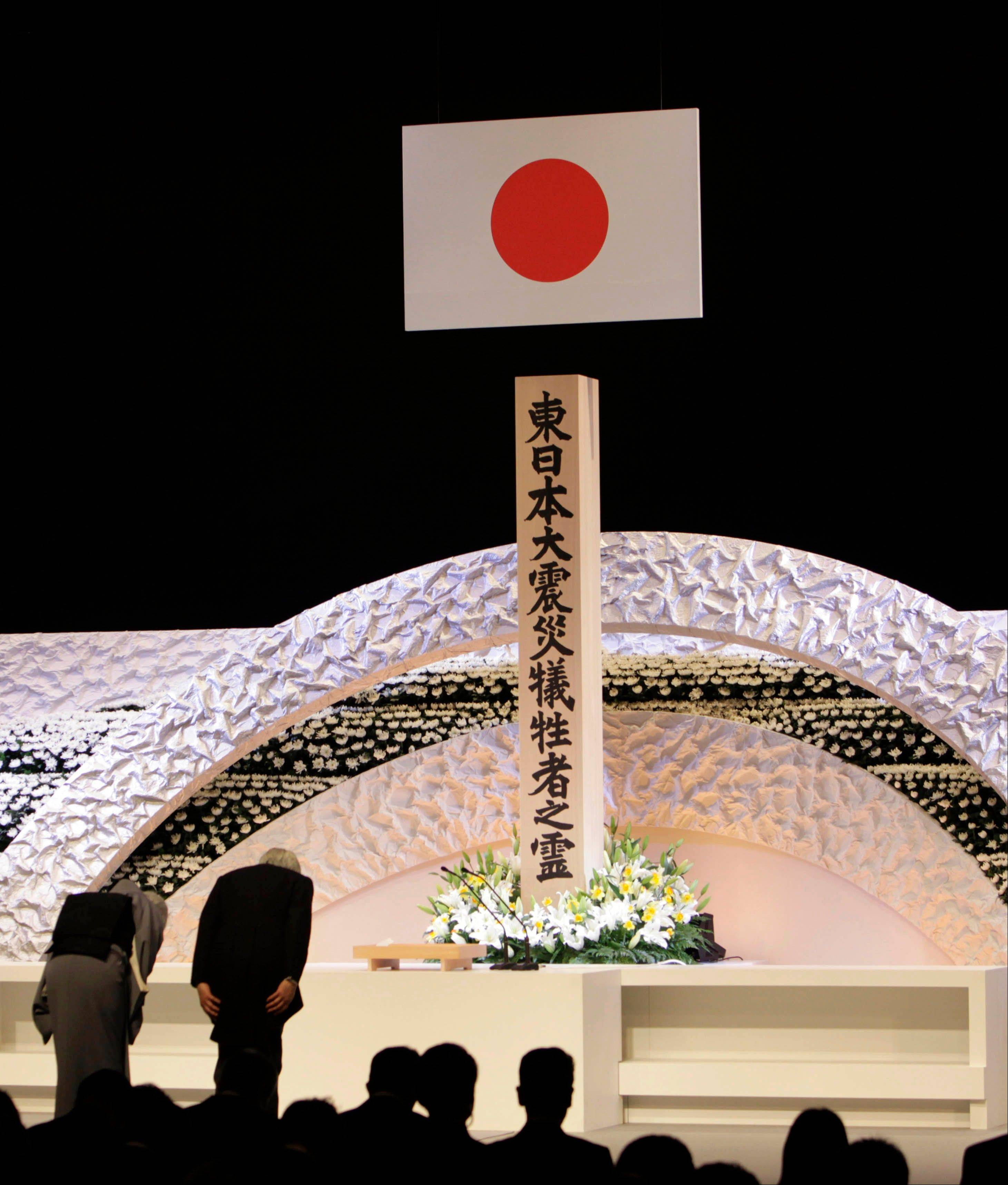 Japanese Emperor Akihito, right, and Empress Michiko bow to pay tribute to the victims of the March 11 earthquake and tsunami at the national memorial service in Tokyo, Monday, March 11, 2013. Japan marked the second anniversary on Monday of the devastating earthquake and tsunami that left nearly 19,000 people dead or missing and more than 300,000 people still displaced.