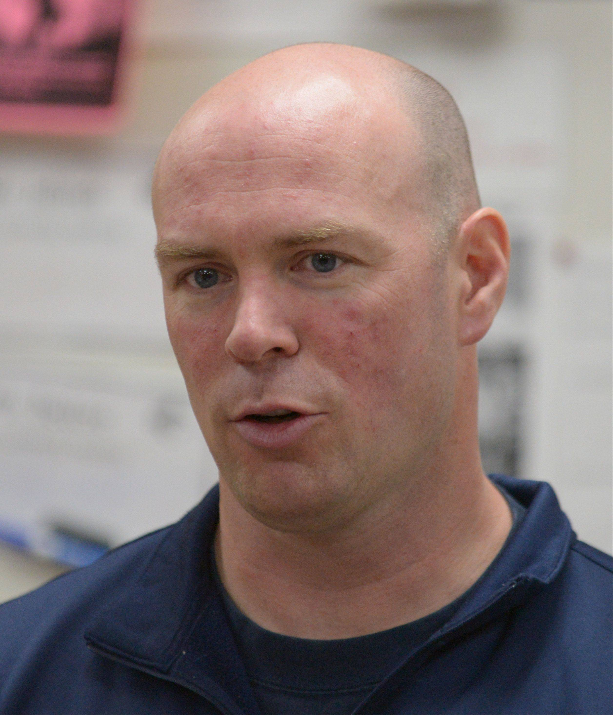 Michael Jelinek, an assistant football coach at North, has helped players become leaders by speaking to them regularly about the components of leadership and service.