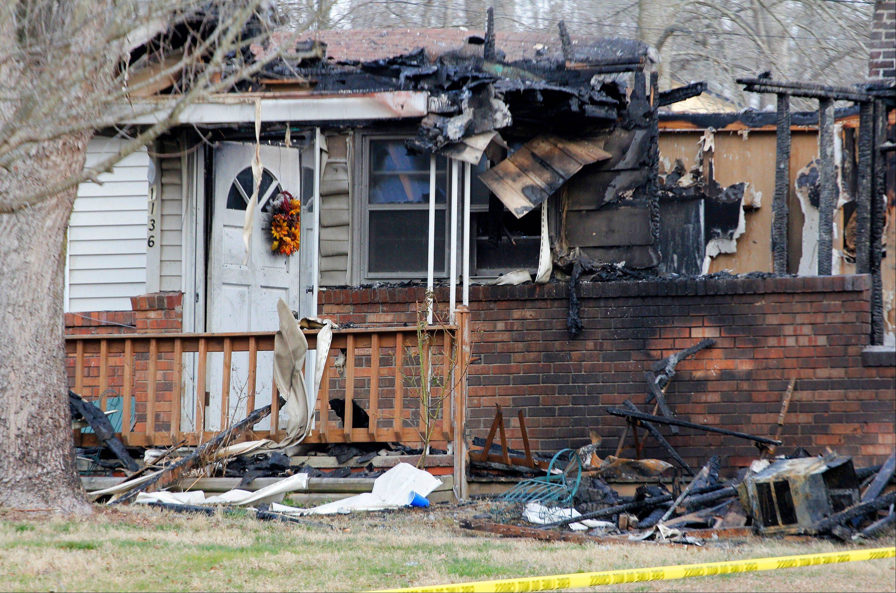 Authorities planned Monday to release more information about a Saturday house fire in the Appalachian foothills of Kentucky that killed a man, his pregnant fiancee and five children.