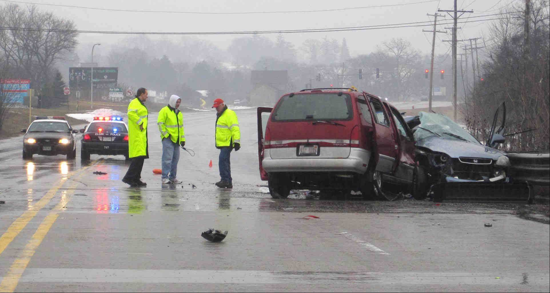 Elgin police at the scene of a crash on Route 20, east of Shales Parkway, that took place at about 2:30 p.m. Sunday. A man died and a woman suffered severe injuries, police said.