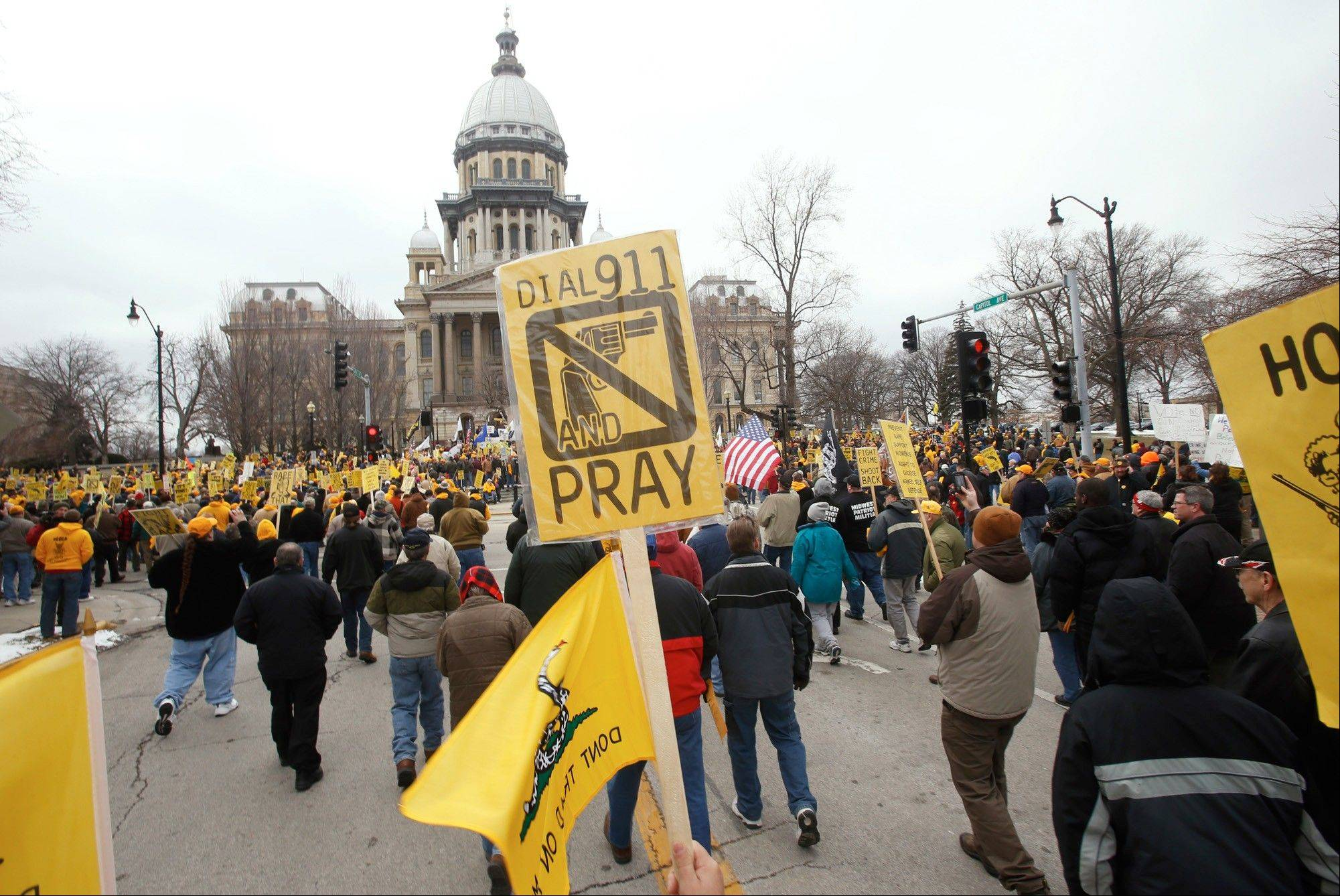Hundreds of gun owners and supporters marched at the state Capitol in Springfield Wednesday in a rally sponsored by the Illinois State Rifle Association, in partnership with IllinoisCarry.com and other groups, including the McHenry County Right to Carry Association.