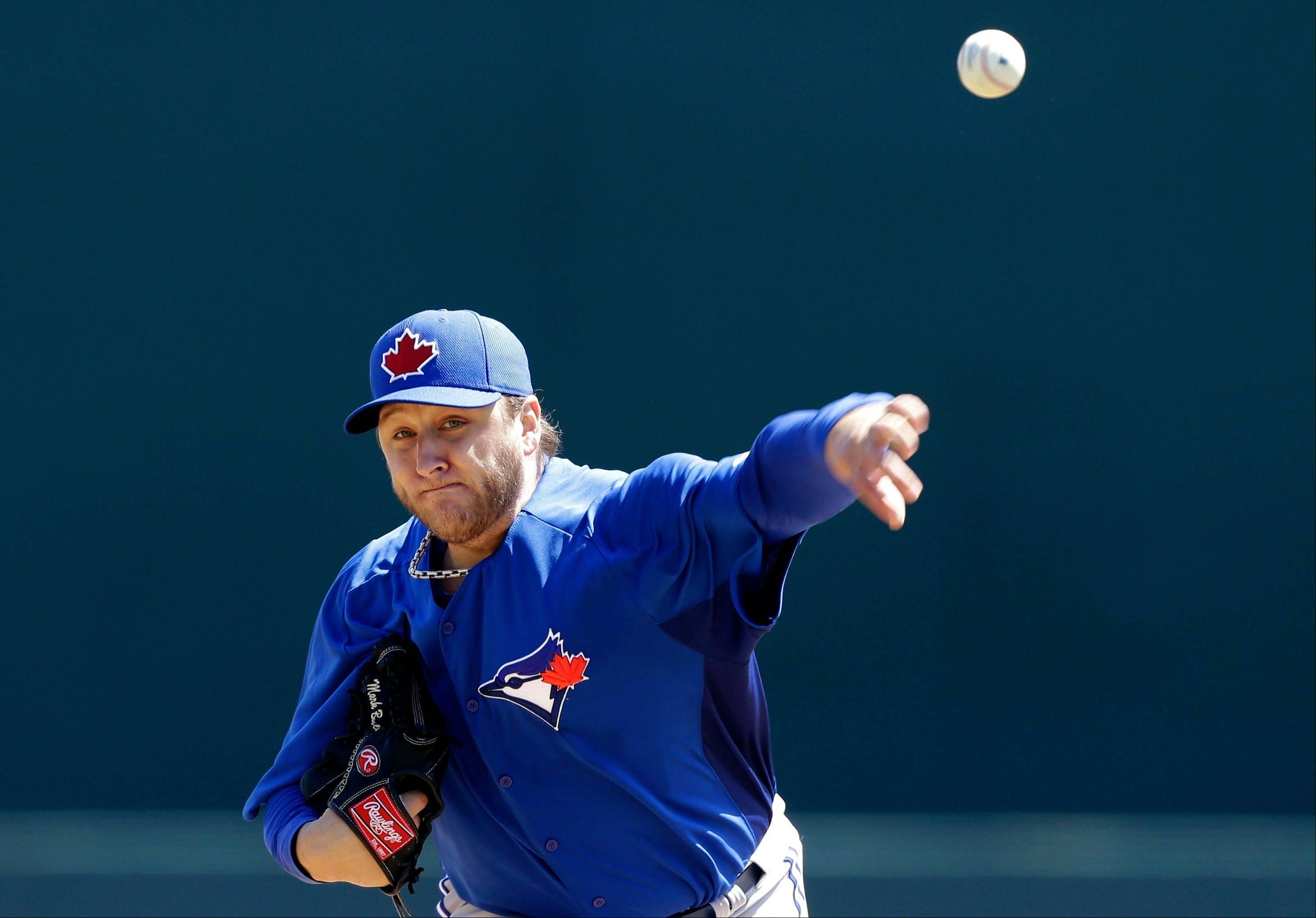 Former White Sox pitcher Mark Buehrle, seen here last week in spring training with the Toronto Blue Jays, escaped the tumultuous Miami Marlins thanks to a 12-player trade.