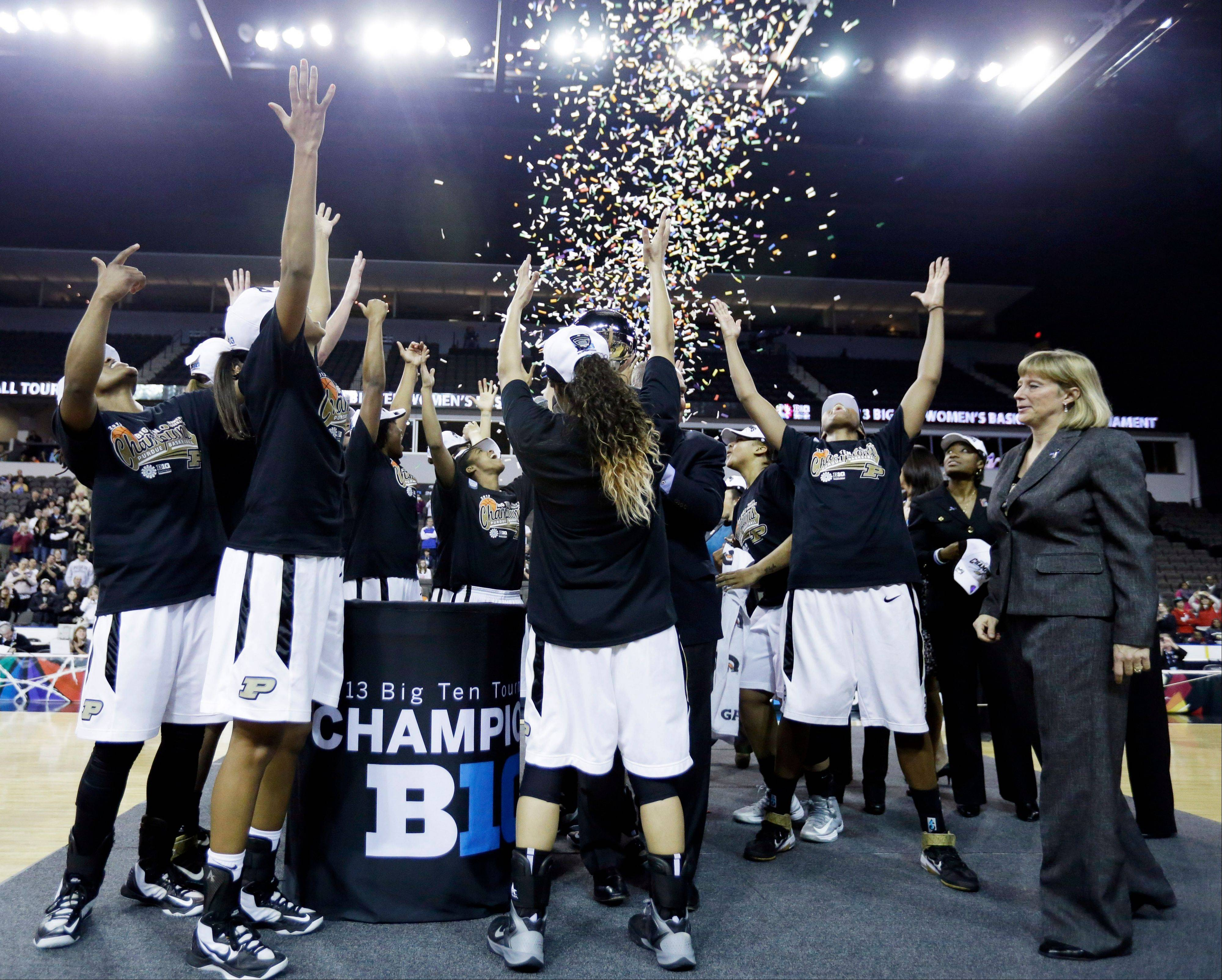 Purdue head coach Sharon Versyp, right, celebrates with her team after their 62-47 win over Michigan State in the championship of the Big Ten Conference tournament Sundat at Sears Centre Arena in Hoffman Estates.