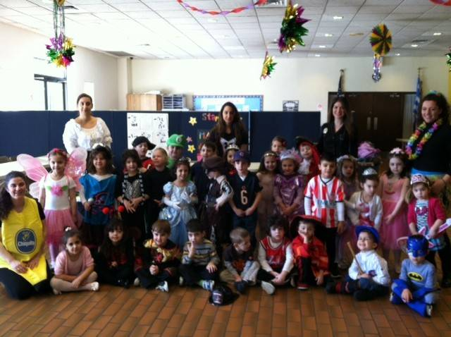Students and teachers dressed up in costumes.