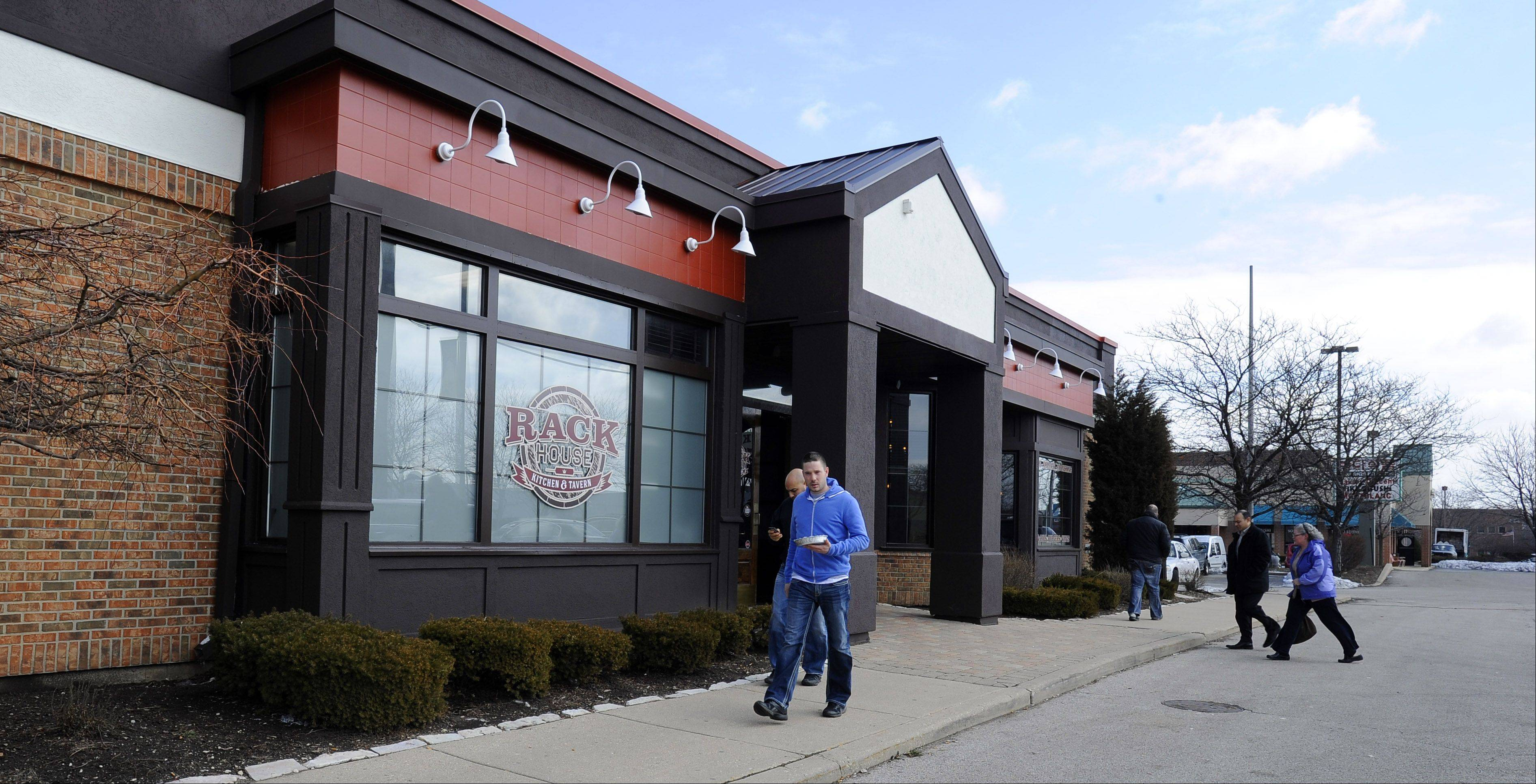 Patrons come and go Tuesday at the Rack House Kitchen & Tavern in Arlington Heights.
