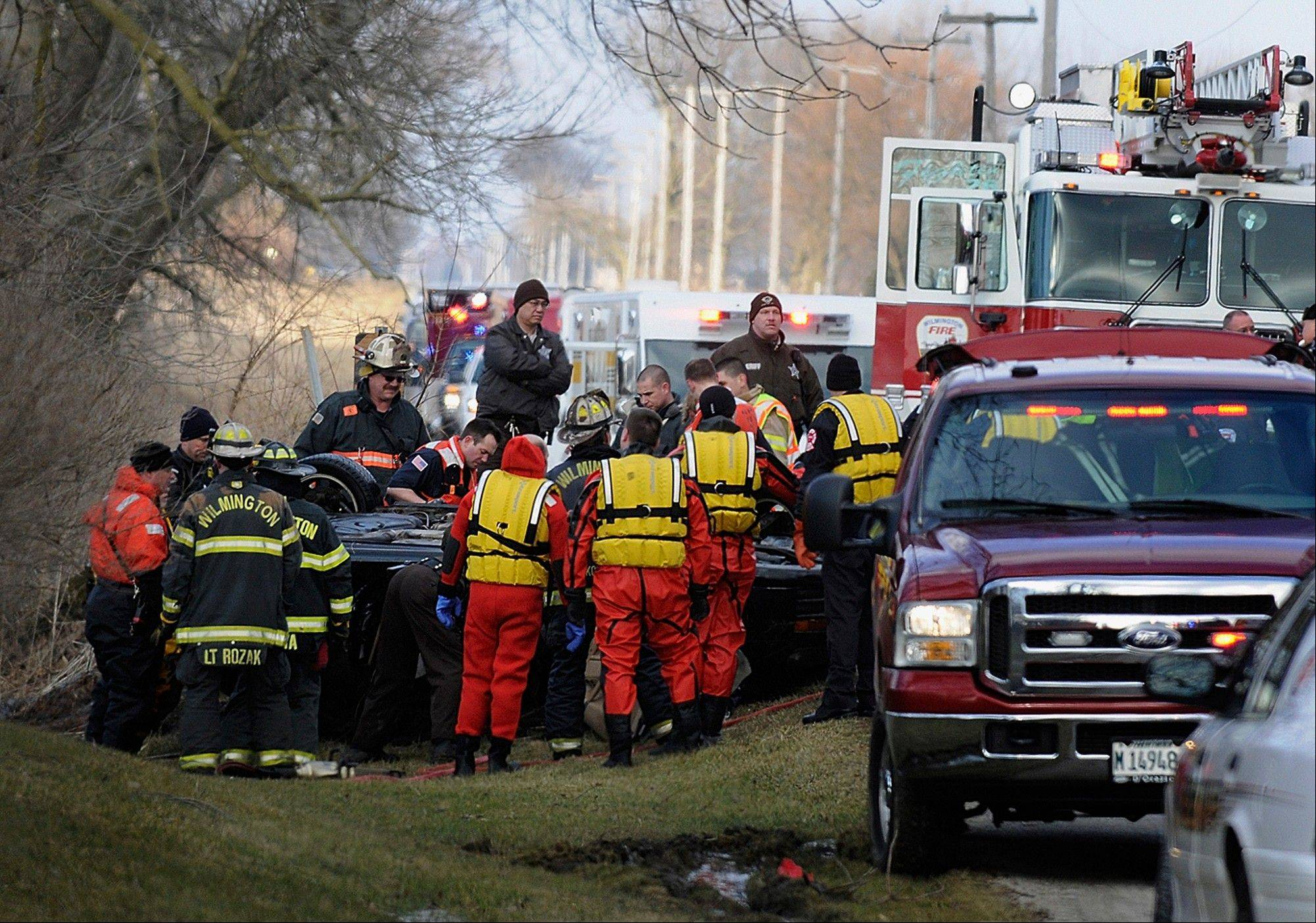 Emergency personnel gather Tuesday at a bridge near Wilmington, as they begin the task of recovering the bodies of four teens, aged from 15 to 17, found in a car that skidded off the bridge into an icy creek. Authorities say the teens had been missing since Monday evening and don't know exactly when the accident occurred.