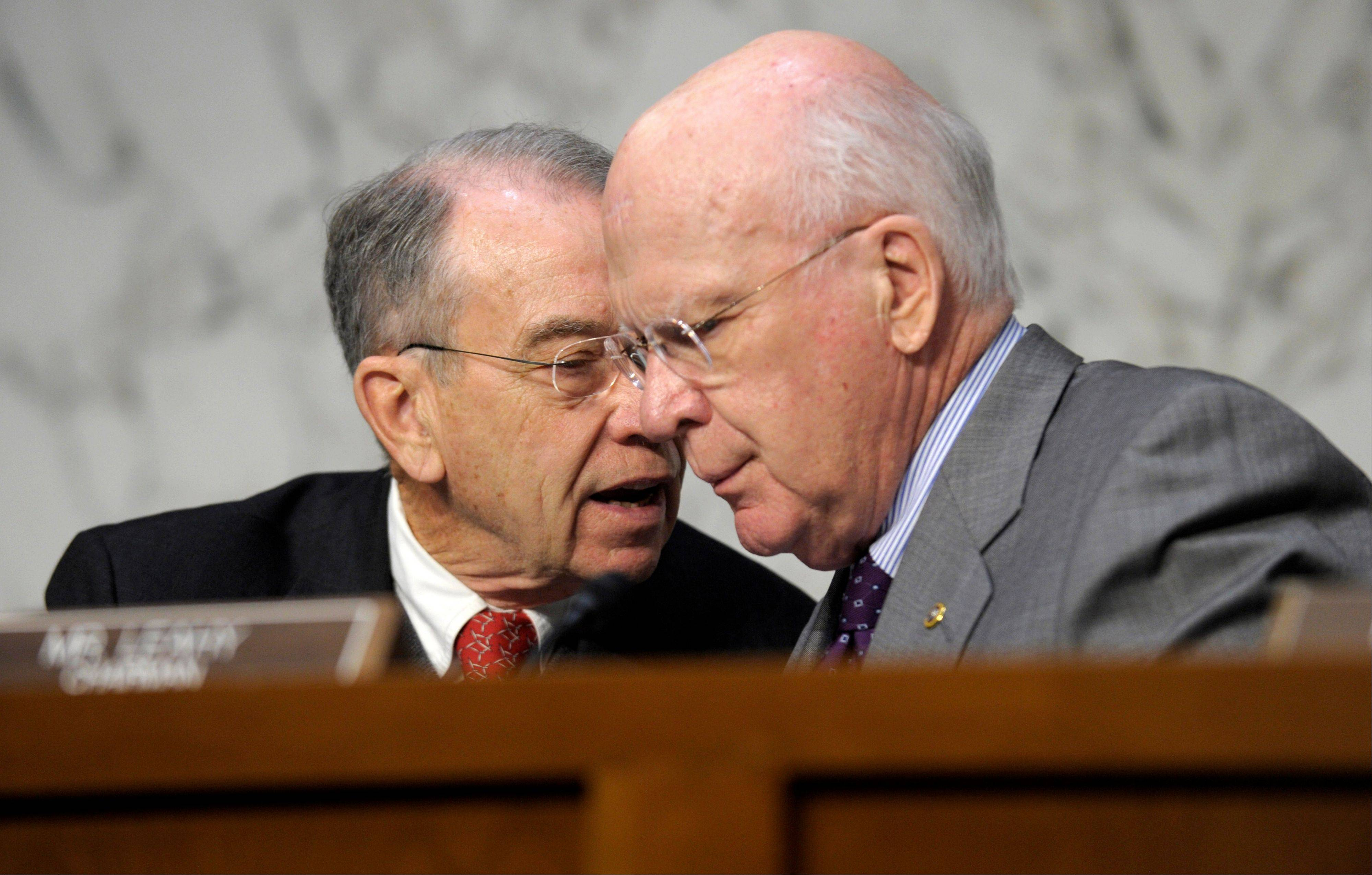 Senate Judiciary Committee Chairman Sen. Patrick Leahy, D-Vt., right, talks with the committee�s ranking Republican Sen. Charles Grassley, R-Iowa. A divided Senate Judiciary Committee approved a Democratic bill Tuesday expanding required federal background checks to nearly all gun purchases, giving President Barack Obama an early victory on curbing gun violence in a fight that still faces difficult odds.