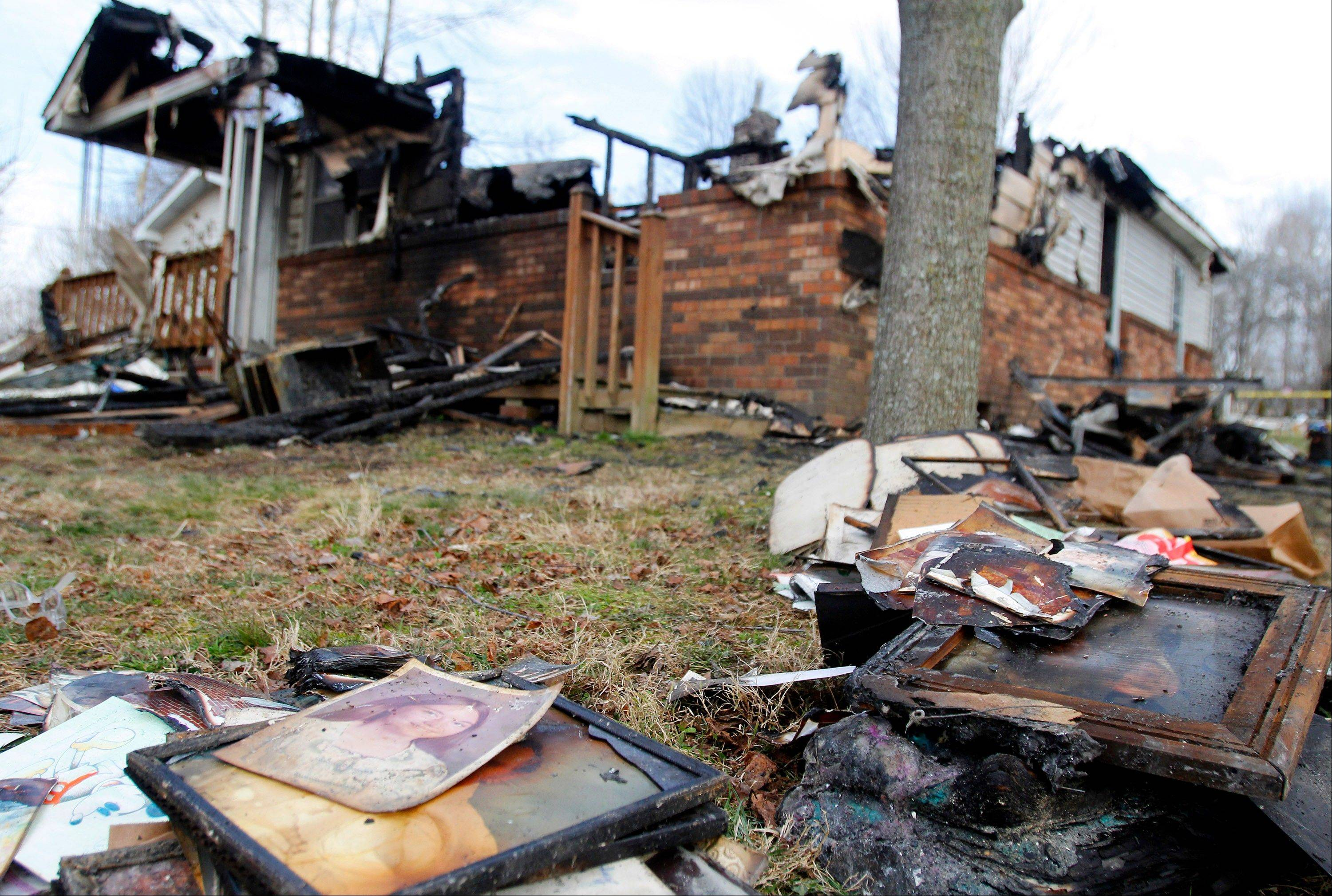 An engaged couple and five children killed in a weekend house fire in southern Kentucky died from smoke inhalation, investigators said Tuesday as they worked to determine the cause of the blaze.