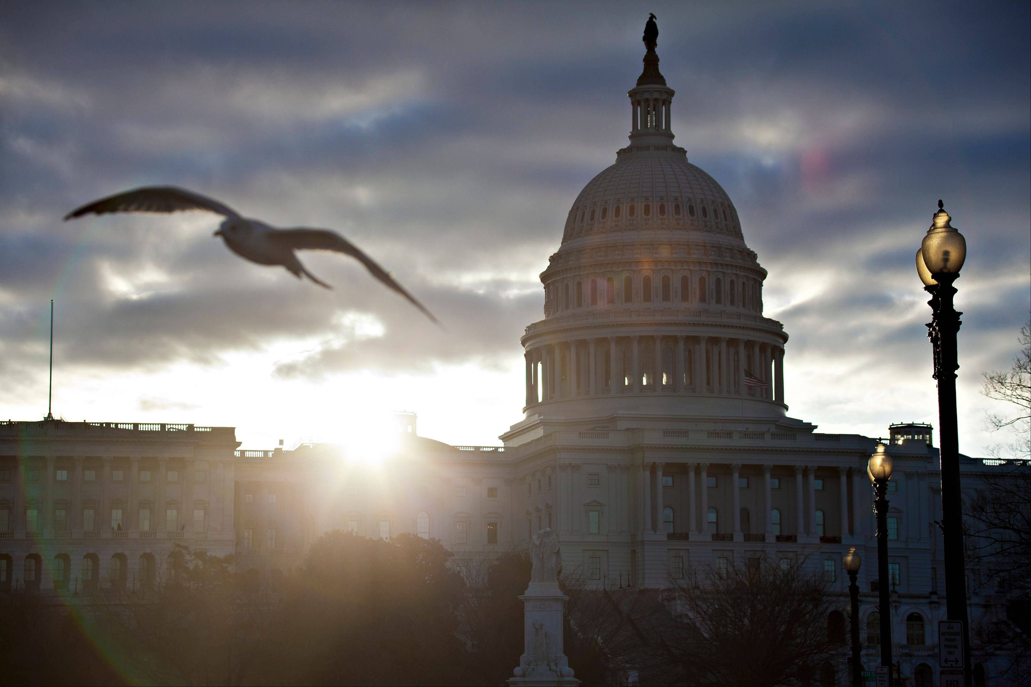 At dawn, the sun breaks through dark clouds over Capitol Hill in Washington. House Republicans put out a video Tuesday to remind visitors that, while they may be locked out of the Obama White House because of budget cuts, the doors to the Capitol are still open for tours.