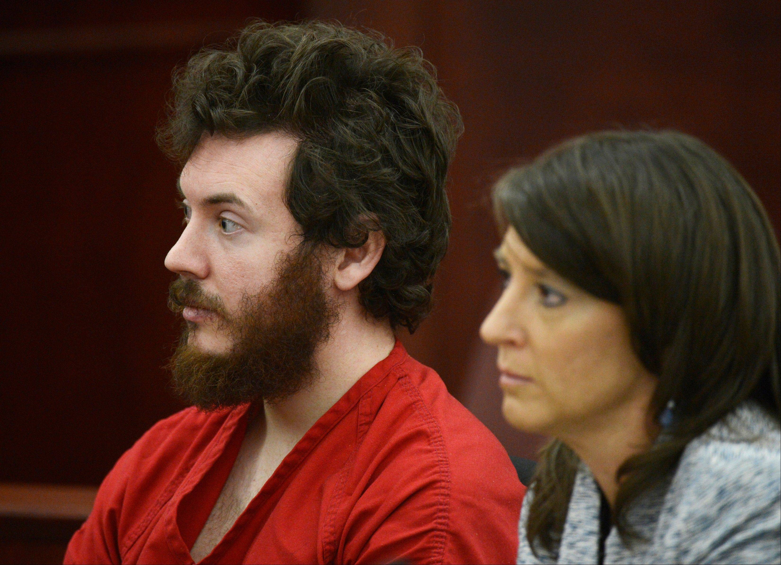 James Holmes sits with defense attorney Tamara Brady during his arraignment in district court in Centennial, Colo., on Tuesday, March 12, 2013.