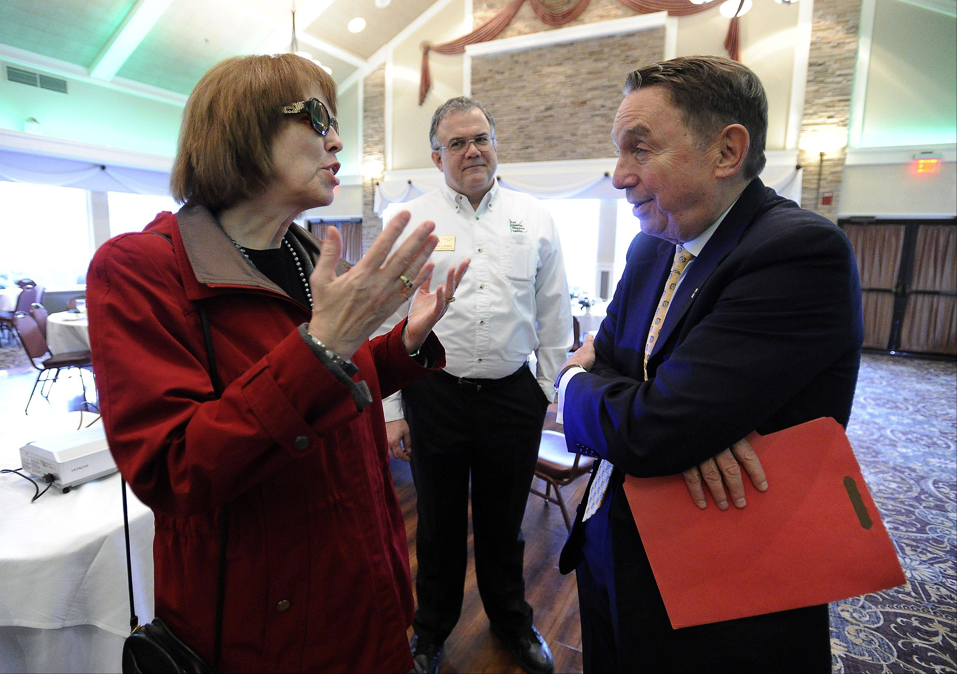 Schaumburg Township Supervisor Mary Wroblewski talks with Roosevelt University Professor Paul Green after he discussed the state of Illinois and national politics at the Schaumburg Business Association�s monthly breakfast meeting Tuesday.