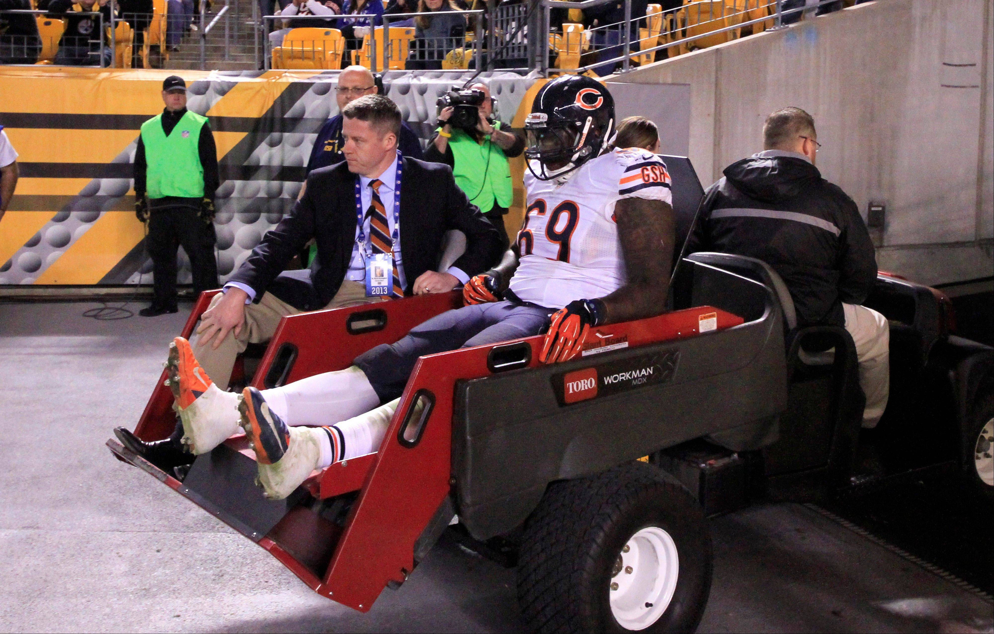 Bears defensive tackle Henry Melton (69) is taken off the field after injuring his left knee in the third quarter Sunday against the Pittsburgh Steelers. Melton will have surgery and miss the rest of the season.