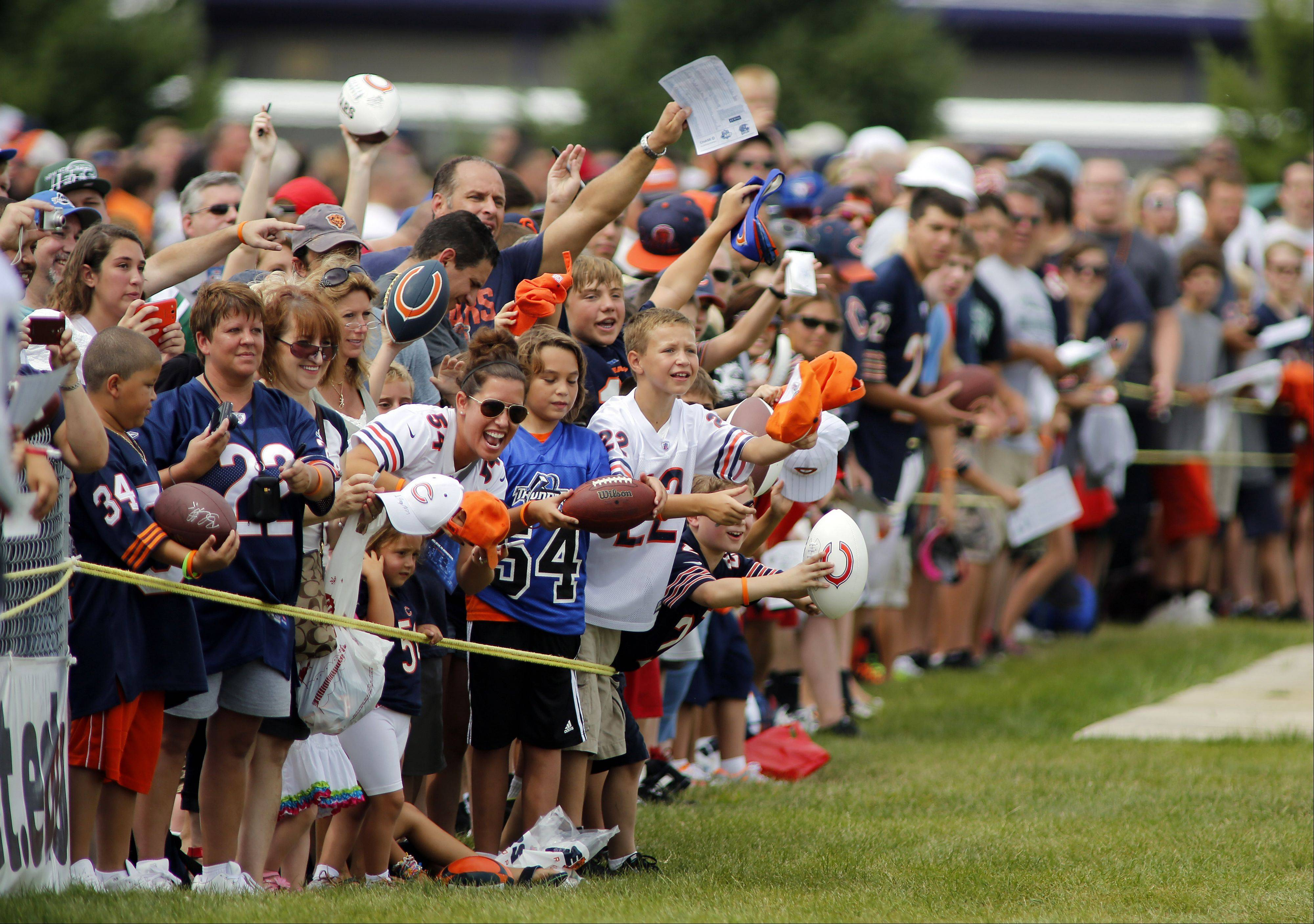 Fans wait for autographs after the Chicago Bears training camp on the campus of Olivet Nazarene University in Bourbonnais last Wednesday. The Bears have agreed to extend their partnership and hold training camp at ONU through 2022.