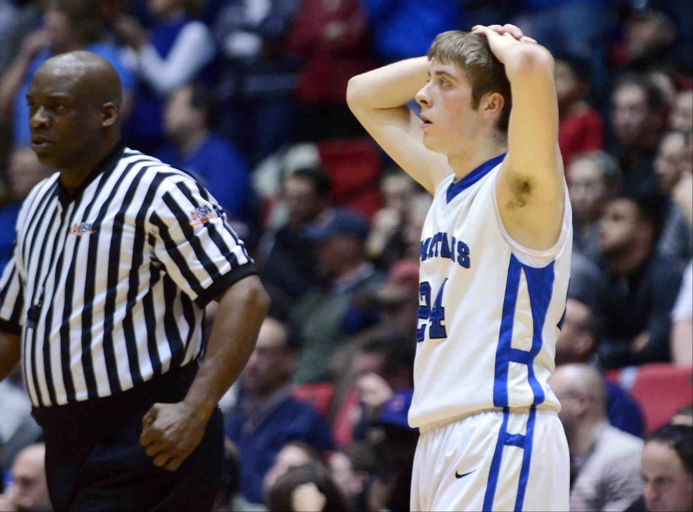 St. Francis� Matt Bonner reacts to committing his fifth foul near the end of the game against Bartonville Limestone Tuesday in the 3A Dekalb supersectional game at the Northern Illinois Convocation Center.