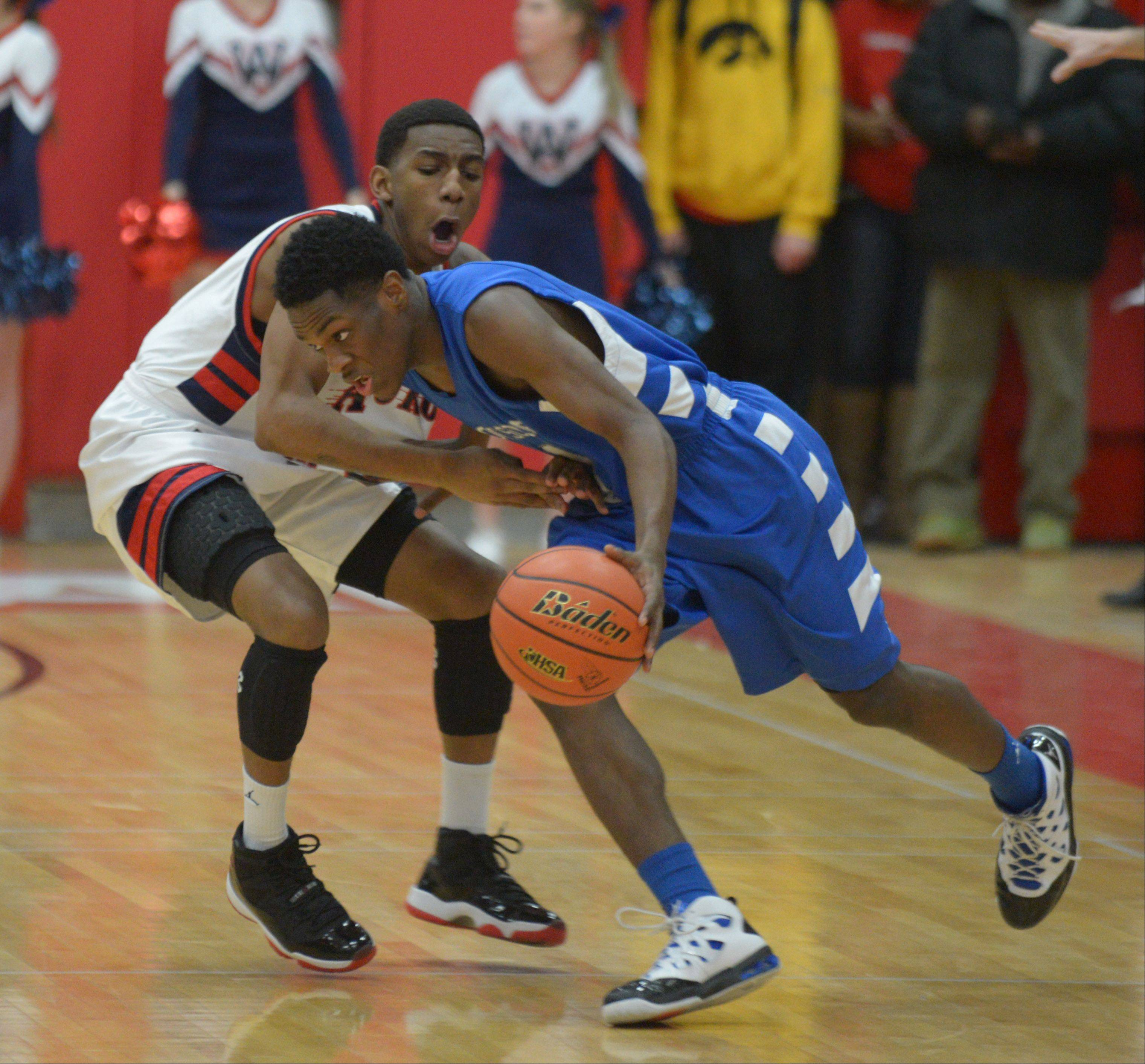 Jayquan Lee of West Aurora works against Paris Lee of Proviso East.