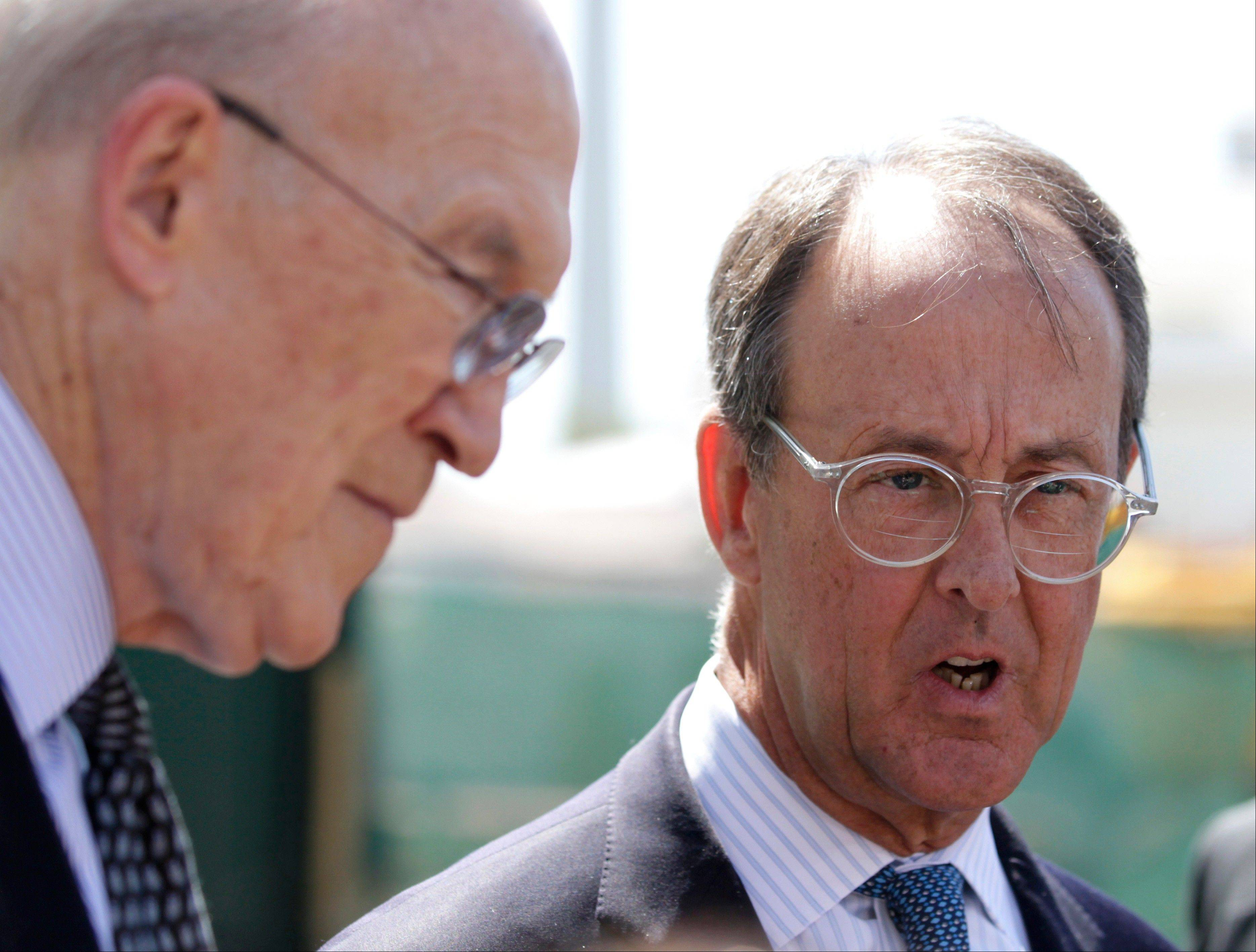 The co-chairmen of the president's deficit reduction commission, Erskine Bowles, right, and Alan Simpson talk to reporters outside the White House in Washington after an April meeting with President Barack Obama in the Oval Office.