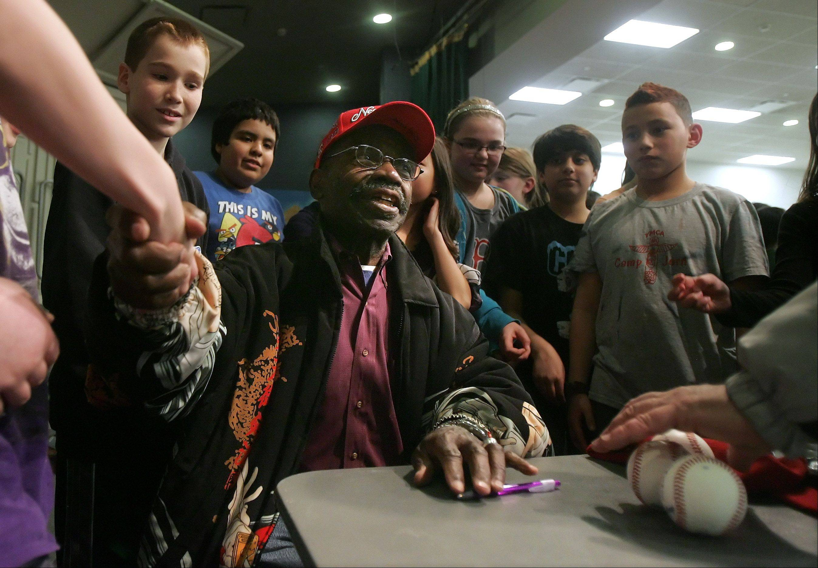 "Negro league baseball player Ray ""Boo Baby"" Knox greets fifth grade students Wednesday at Woodland Intermediate School in Gurnee, where he joined Hank ""Baby"" Presswood to discuss their time in the league as part of Black History Month. Presswood played with the Cleveland Buckeyes and the Kansas City Monarchs from 1948 to 1952 and Knox played with the Chicago American Giants in 1952."