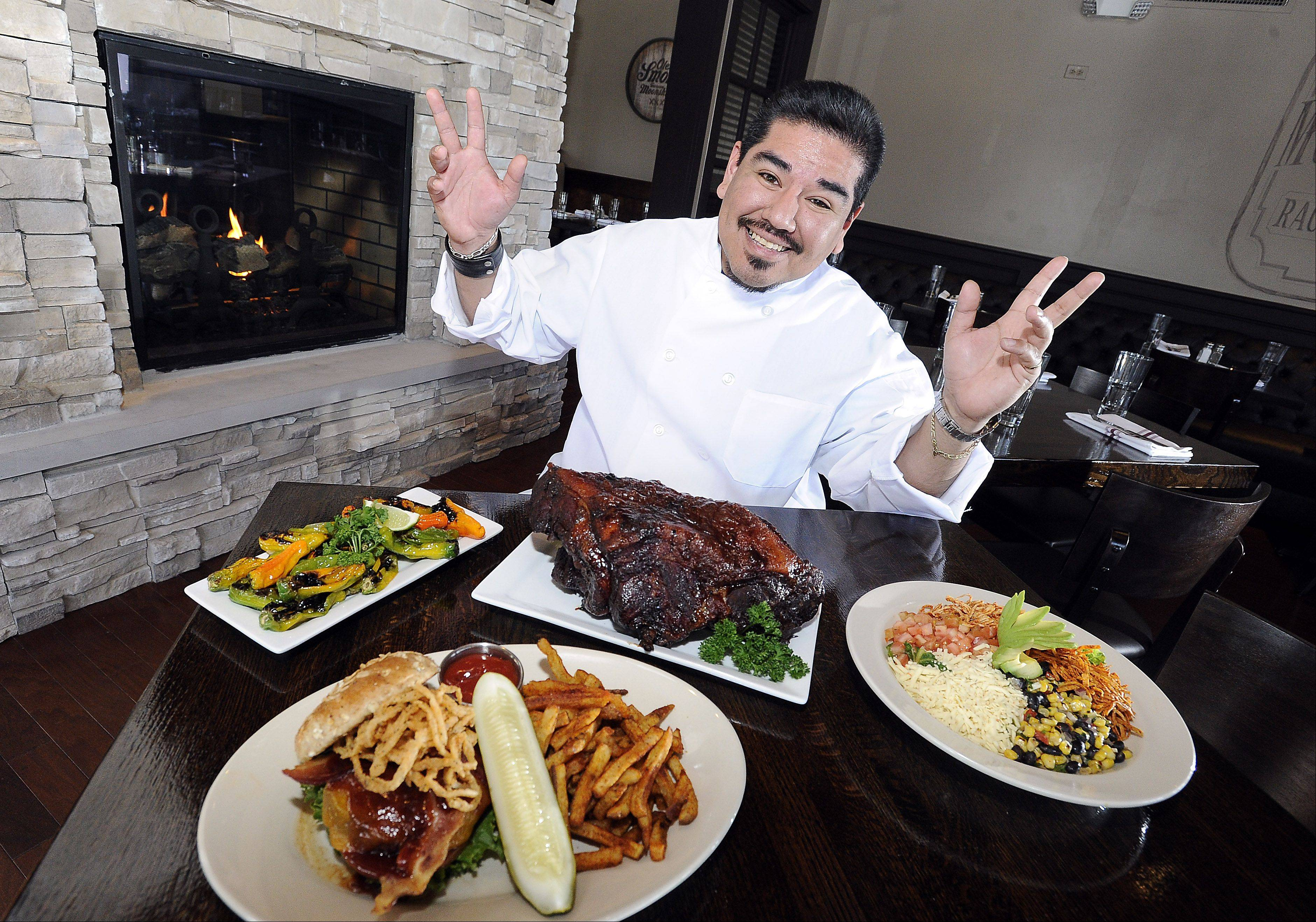 Corporate Chef Nestor Soto shows off some of the dishes he serves up for patrons.