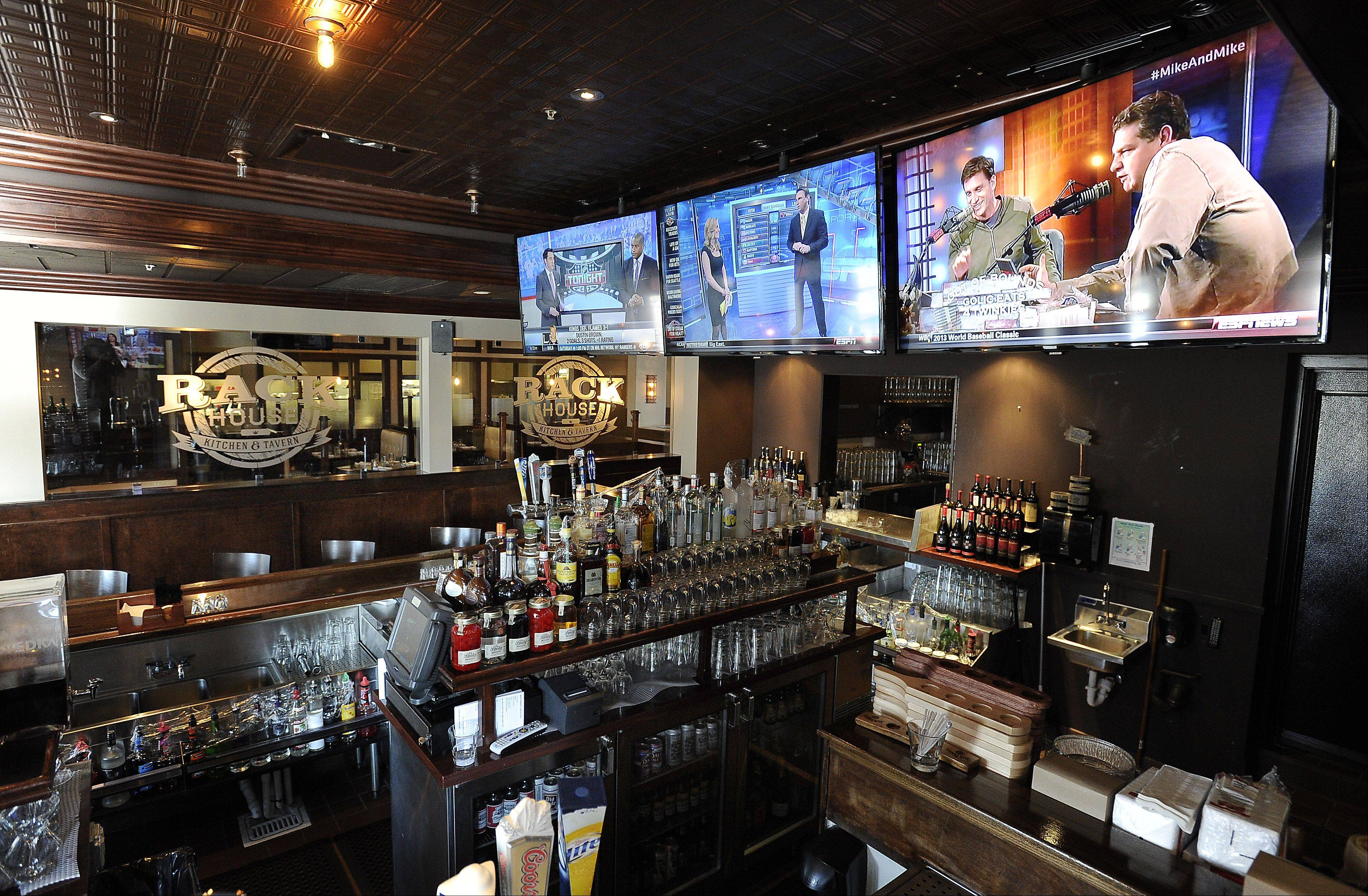 Big screen monitors are on display at the bar.