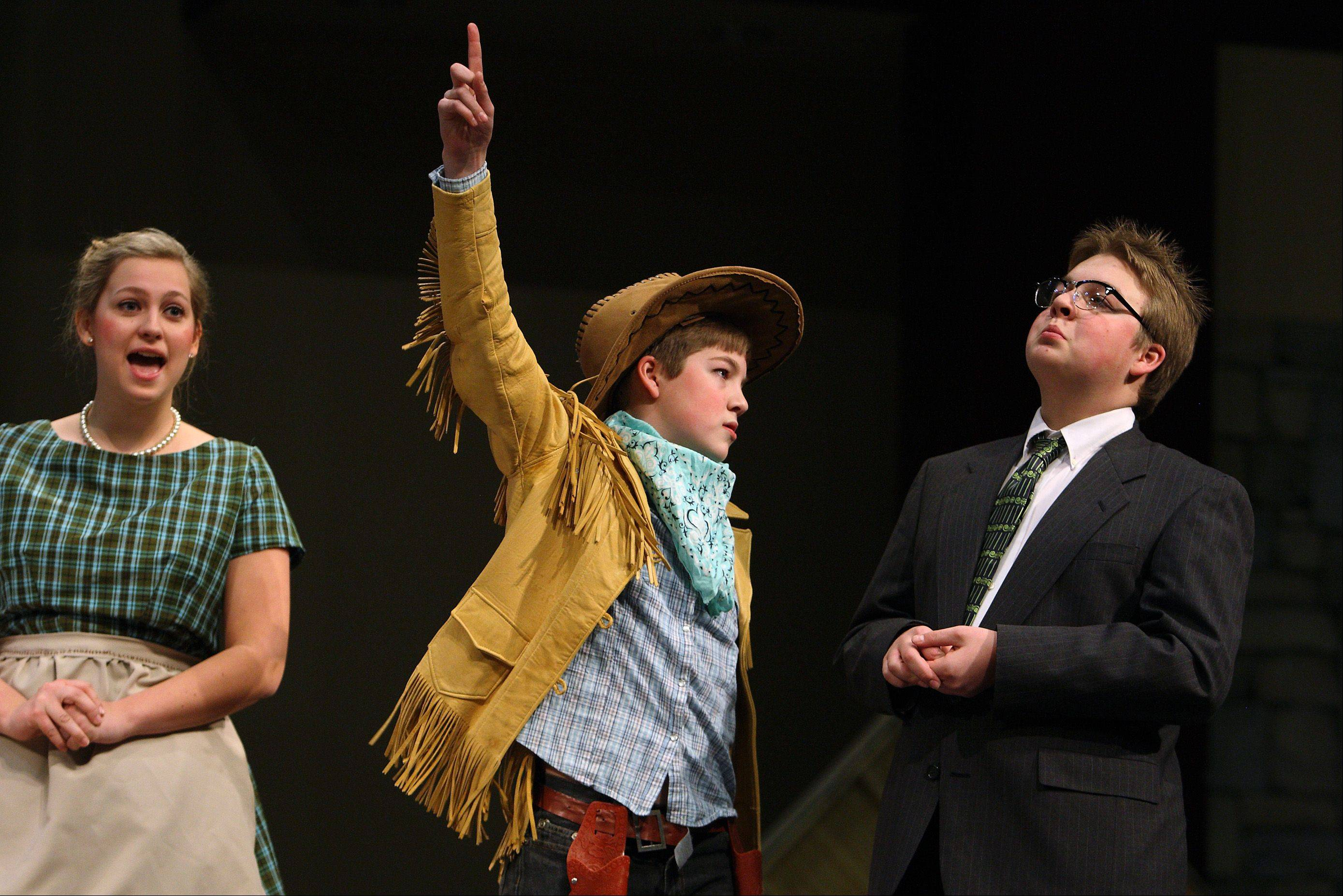 "Olivia Thiel as Ms. Teavee, along with Jake Mickel as Mike Teavee and John Mickel as Phineous Trout in ""Willy Wonka Wonka and the Chocolate Factory."""
