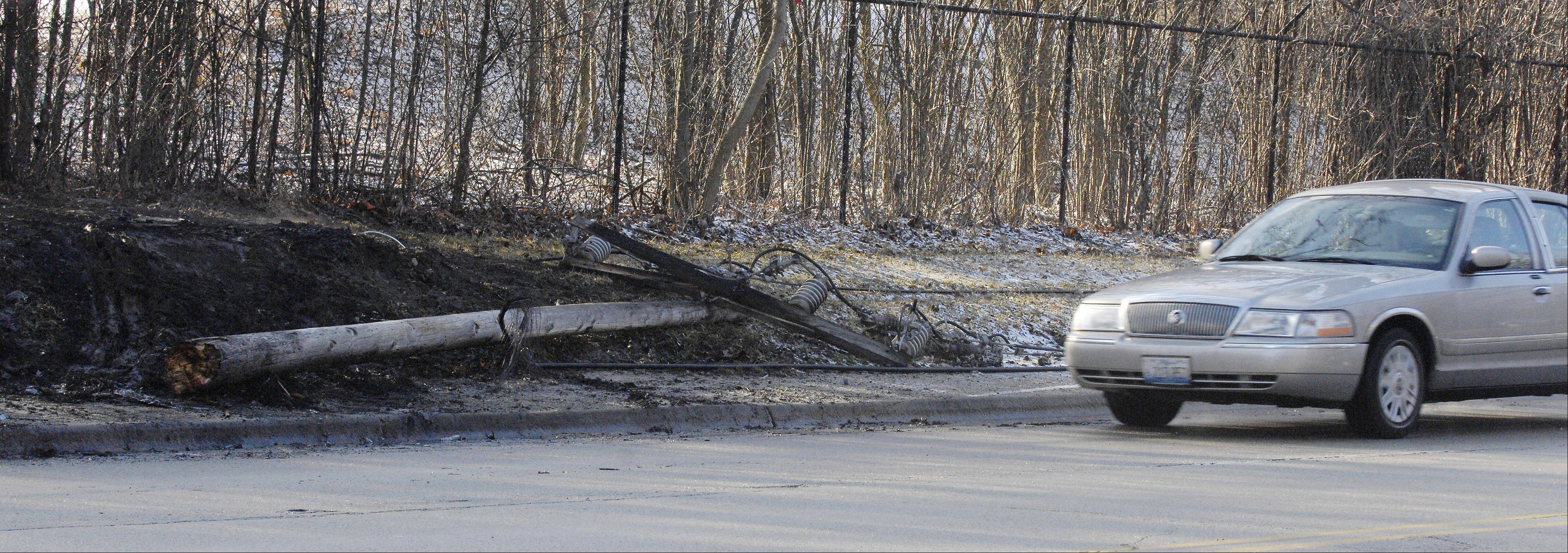 An early-morning crash on Winfield Road in unincorporated DuPage County resulted in a downed utility pole and a car engulfed in flames. The stretch of Winfield Road between Roosevelt and Mack roads was closed.