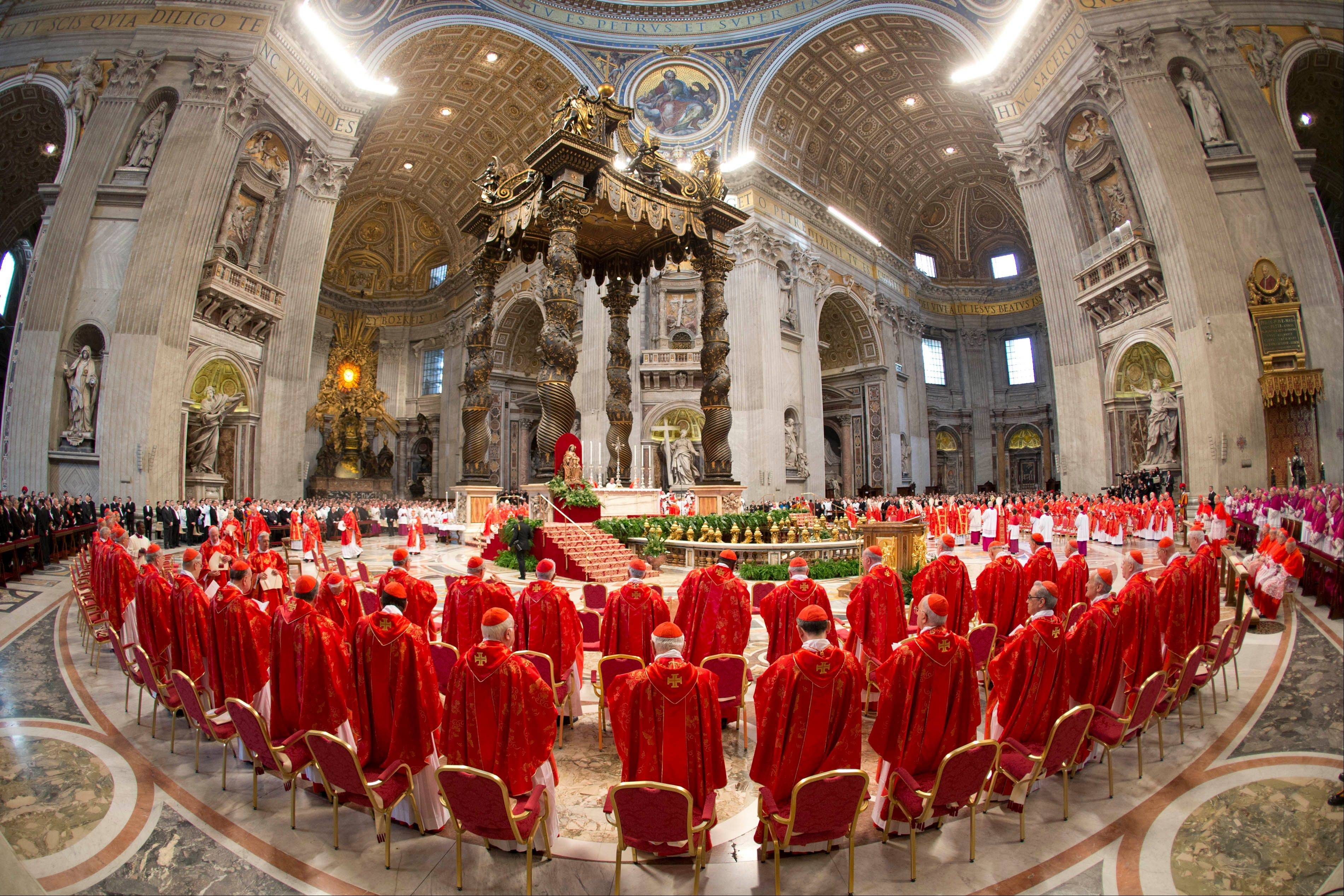 Cardinals attend a Mass Tuesday for the election of a new pope celebrated by Cardinal Angelo Sodano inside St. Peter's Basilica at the Vatican.