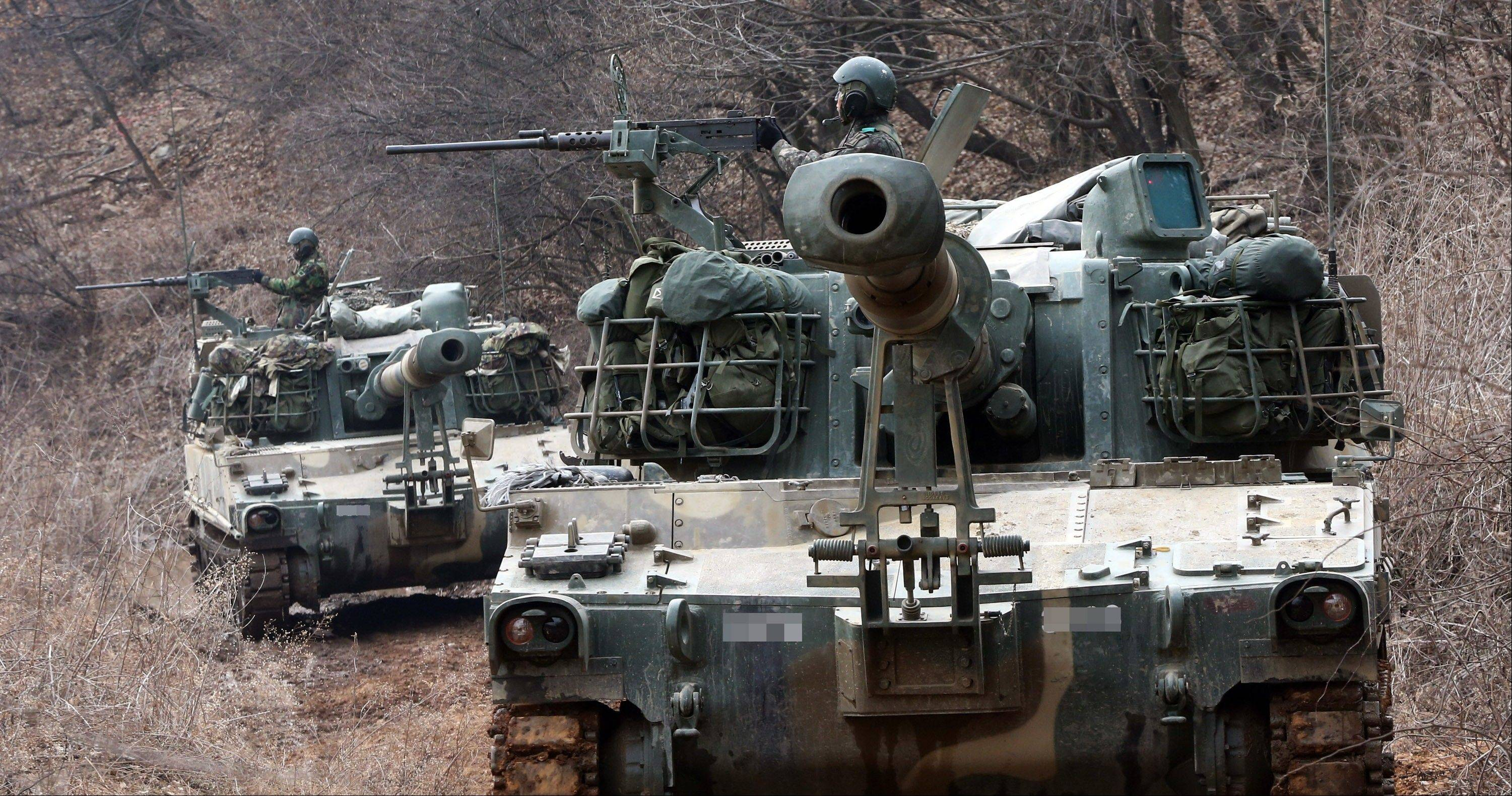 "South Korean army K-55 A1 self-propelled artillery vehicles move Tuesday during an exercise against possible attacks by North Korea near the border village of Panmunjom in Paju, South Korea. North Korea's leader Kim Jong Un urged front-line troops to be on ""maximum alert"" for a potential war as a state-run newspaper said Pyongyang had carried out a threat to cancel the 1953 armistice that ended the Korean War."