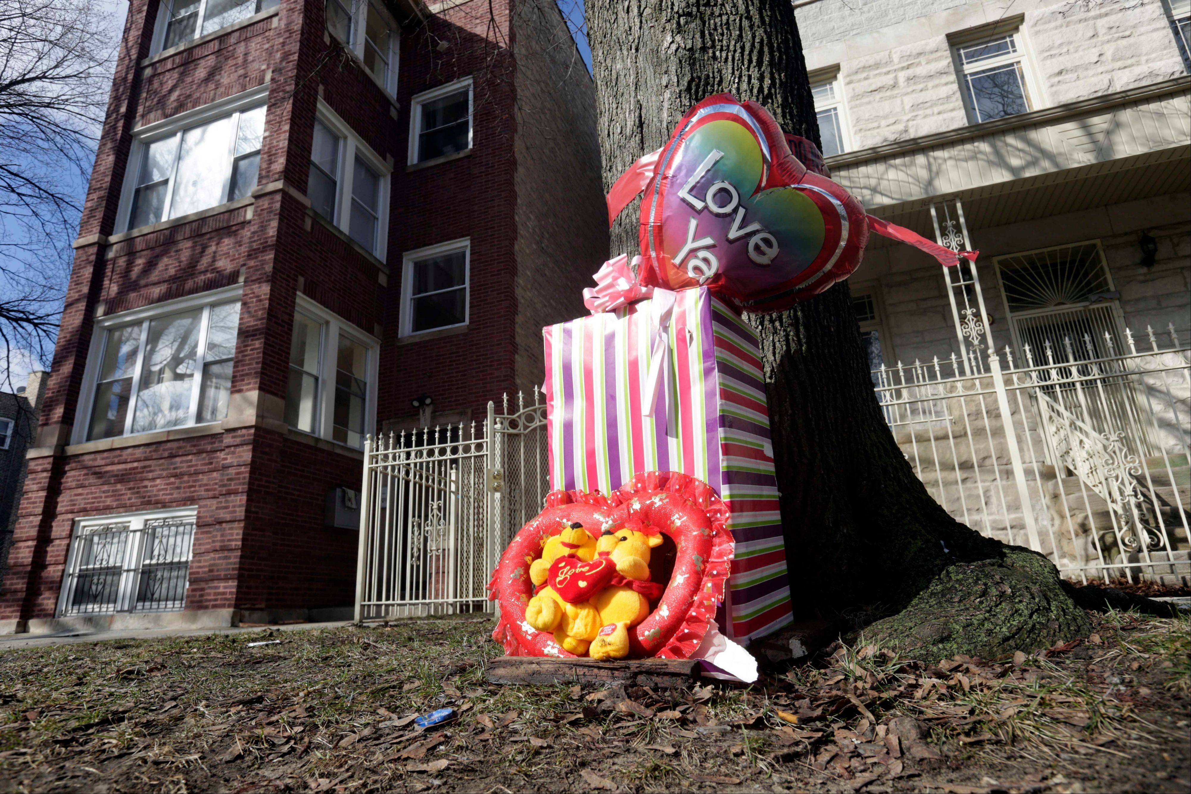 A makeshift memorial has been placed at the site where 6-month-old girl Jonylah Watkins and her father were shot Monday on the South Side. The baby, who was shot five times, died Tuesday morning.
