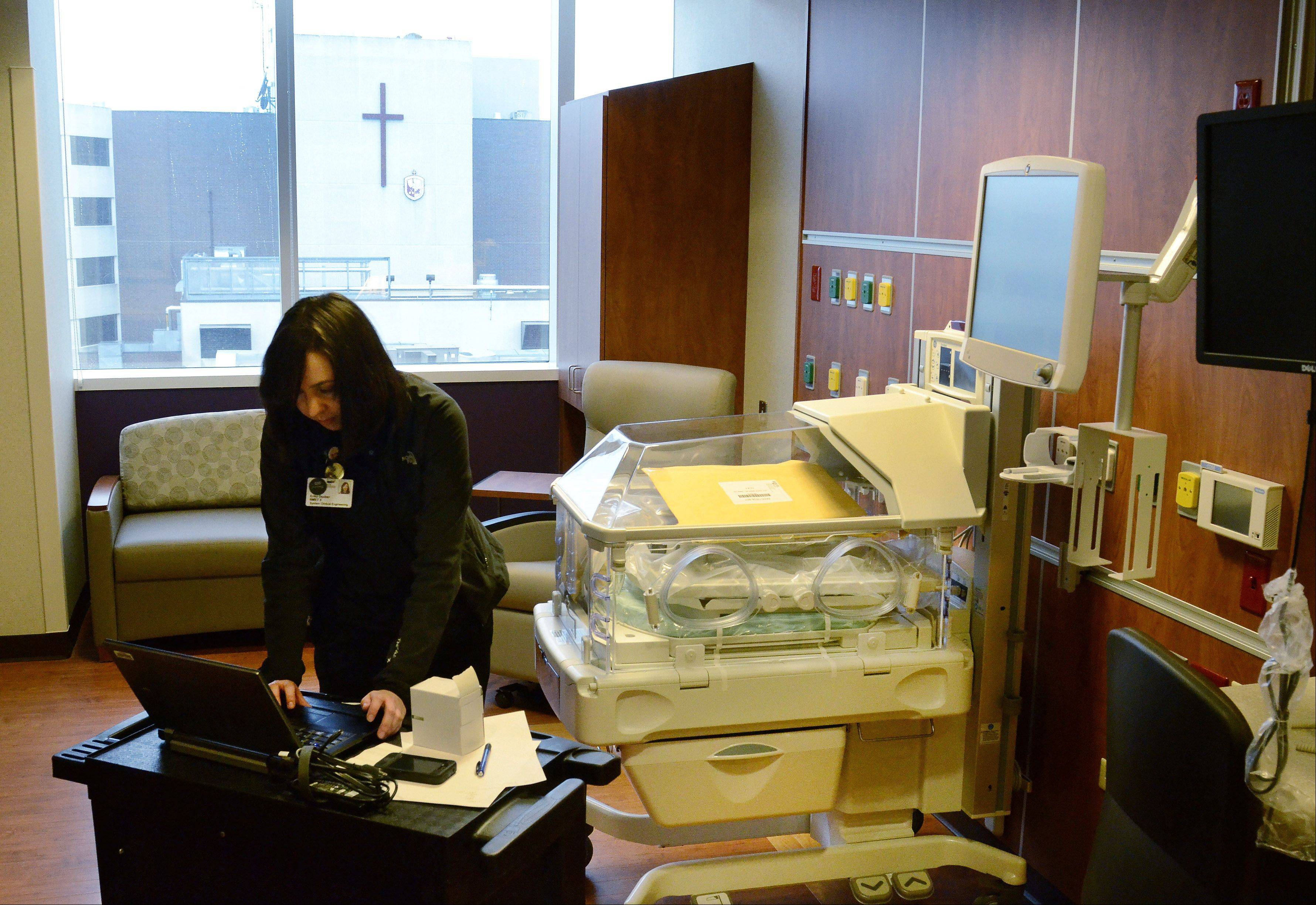 Biomed Technician Erika Dauber sets up a new $30,000 incubator in one of the patient rooms at the new Alexian Brothers Women and Children's Hospital.