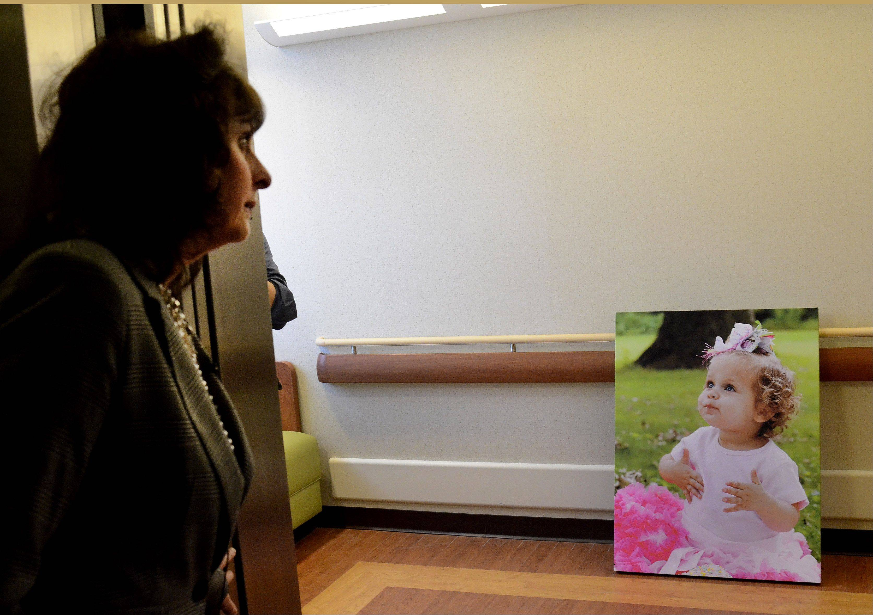 An example of some child friendly artwork waits to be hung as Executive Director of Nursing Joan Cappelletti leads a tour of the new Alexian Brothers Women and Children's Hospital.