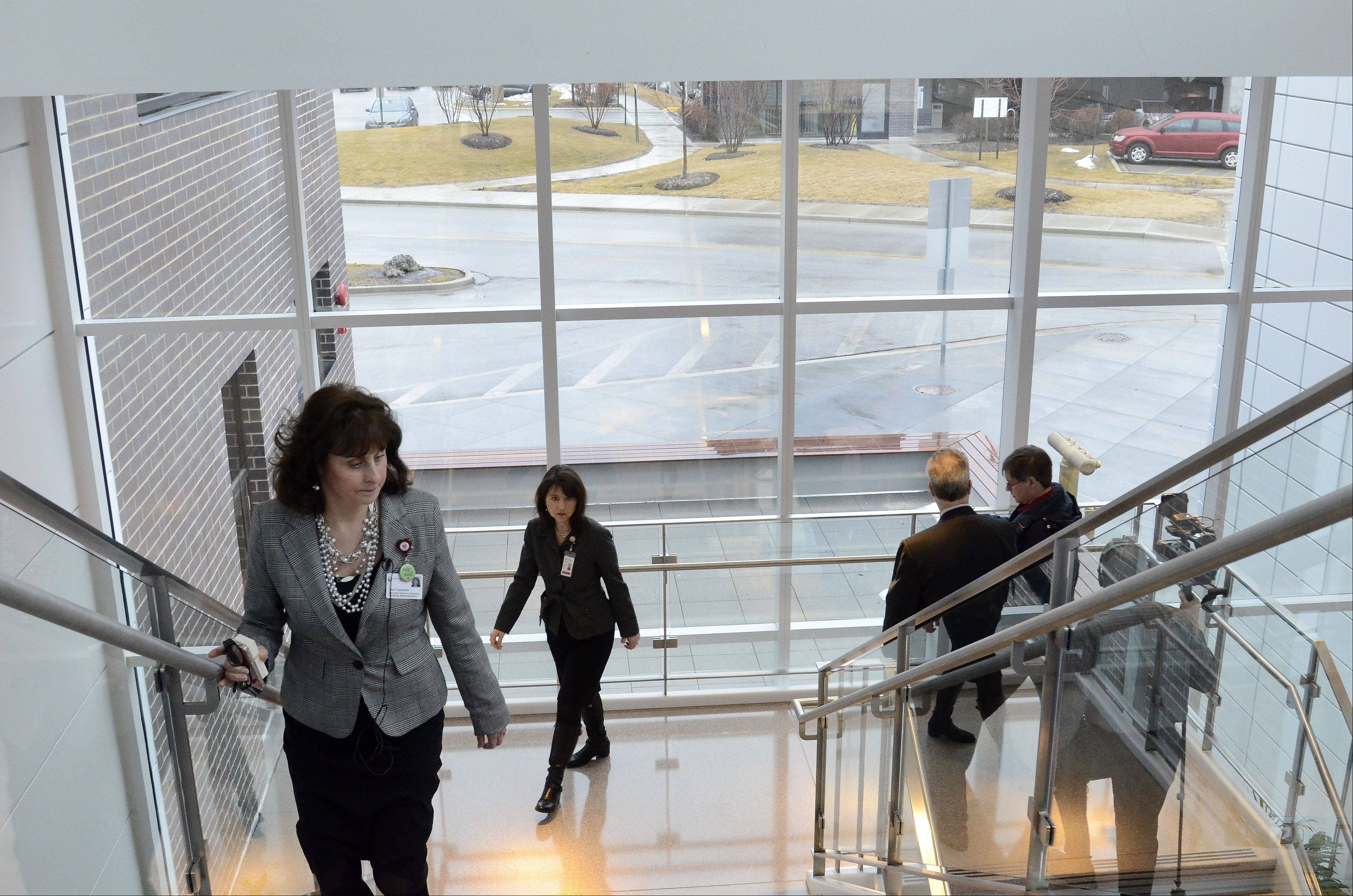 Executive Director of Nursing Joan Cappelletti leads a tour of the new hospital.