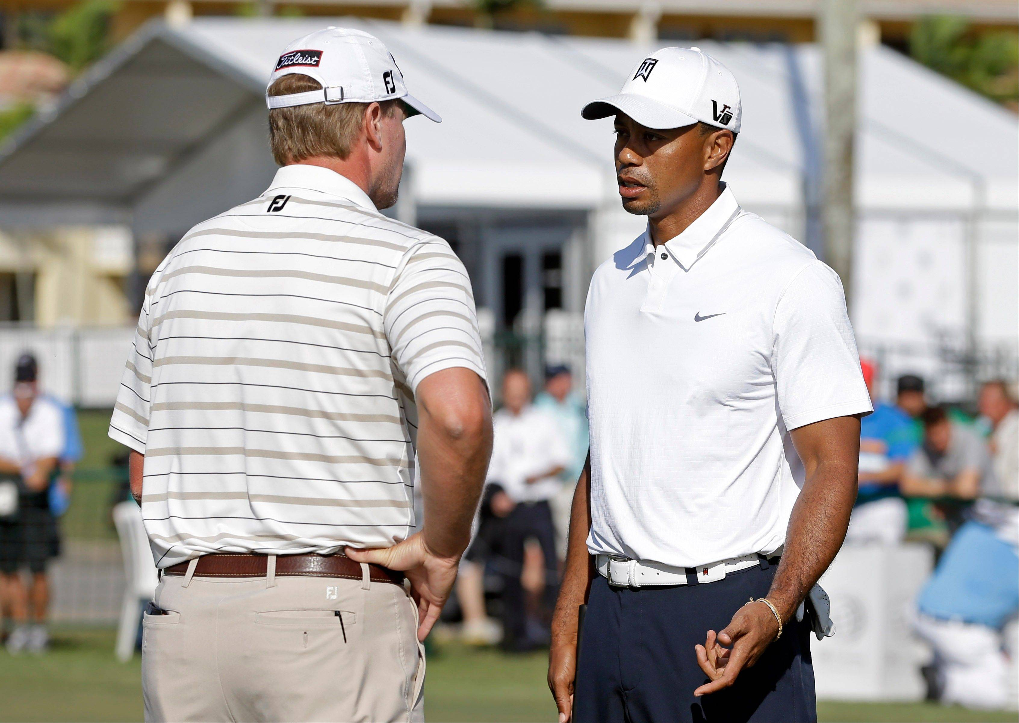 Former Ryder Cup partners Tiger Woods, right, and Steve Stricker finished first and second, respectively, at the Cadillac Championship golf tournament. Woods credited Stricker with helping him work on his putting.