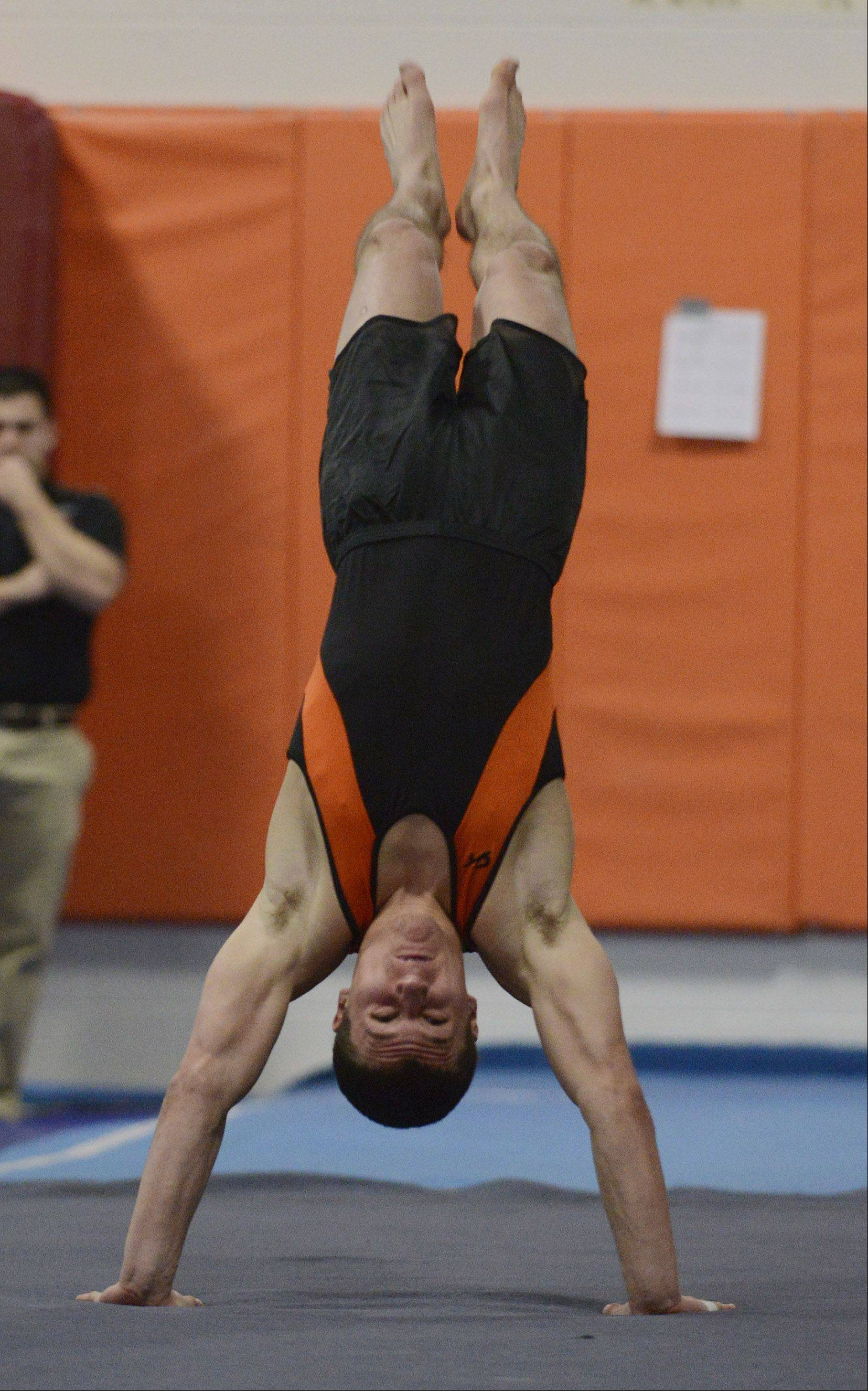 Libertyville's Jack Burke competes on the floor exercise during Saturday's boys gymnastics meet at Libertyville High School.