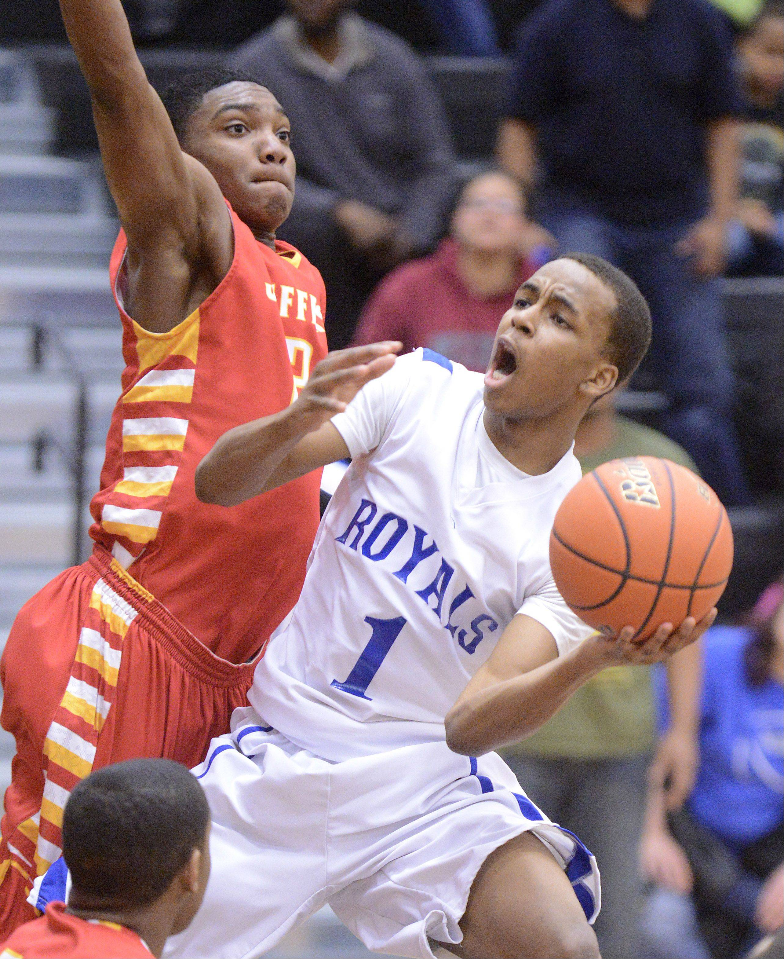 Rockford Jefferson's Antonie Pittman, left, pressures Larkin's Quantice Hunter Wednesday in Dekalb.