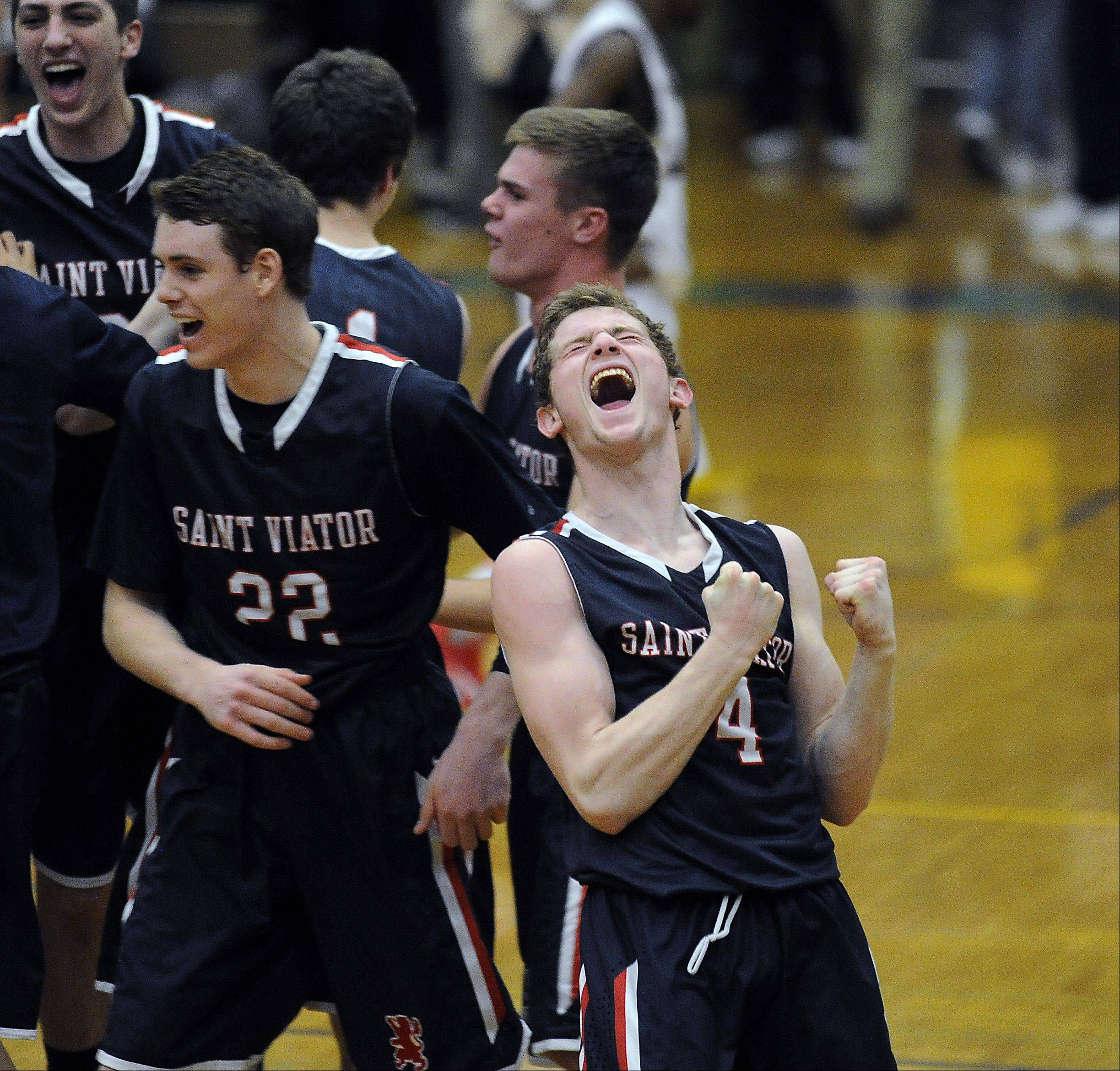 St. Viator's Kevin Hammarlund celebrates their victory over Zion-Benton in the Class 4A Waukegan sectional semifinal basketball game on Thursday.
