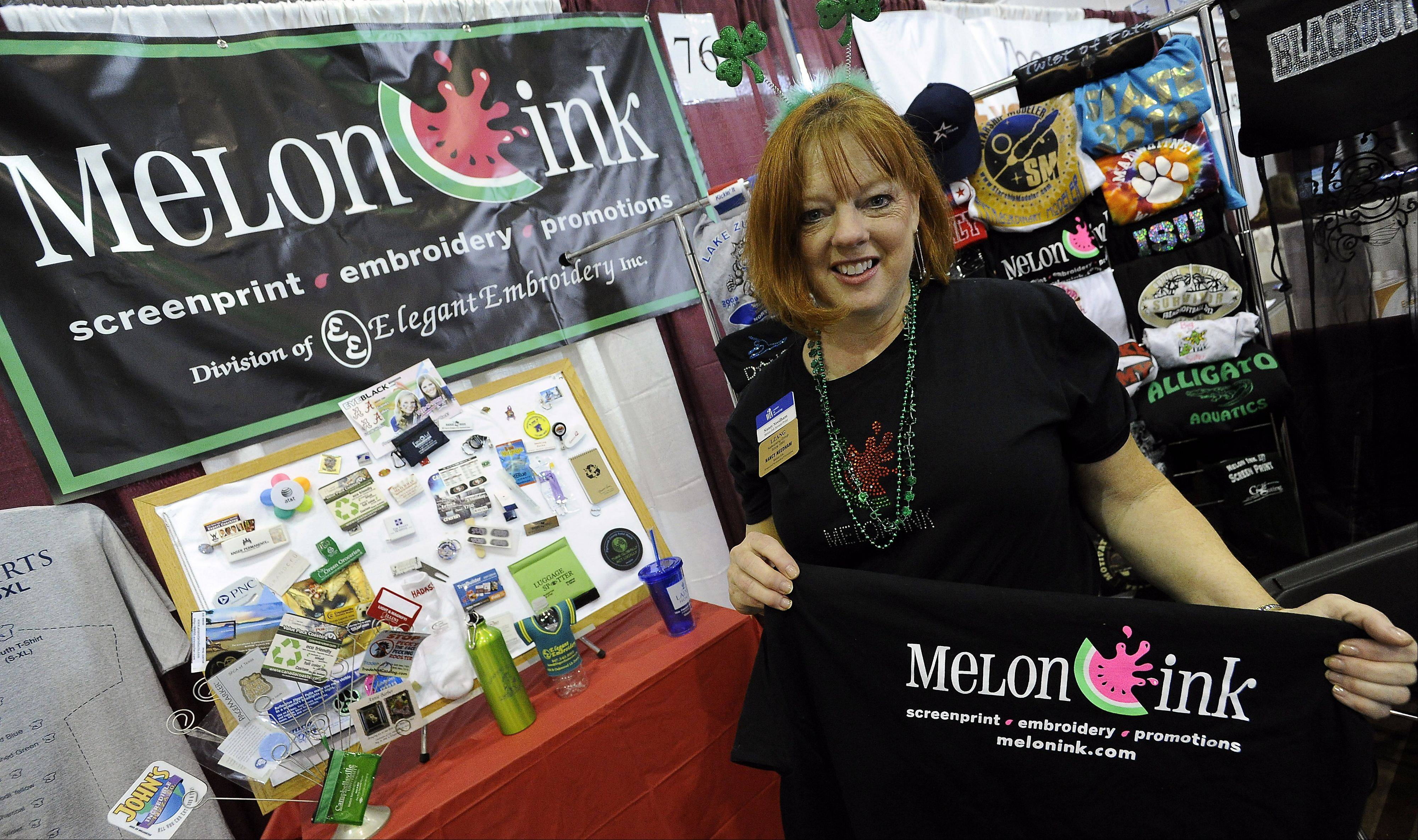 Nancy Needham, president of Melon Ink and Elegant Embroidery, Inc. of Lake Zurich, shows off her products at the 2012 Lake Zurich Chamber business expo.