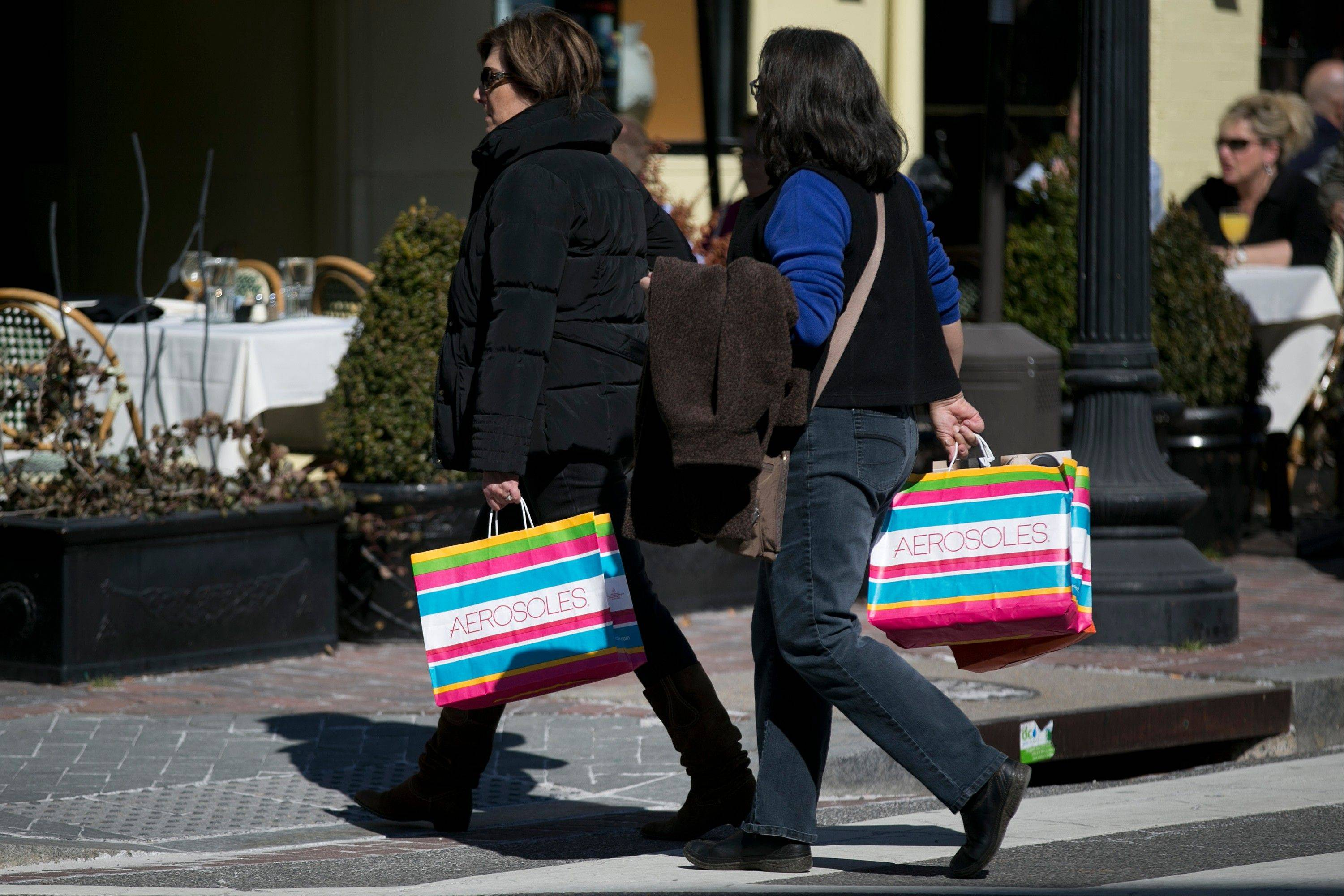 Bloomberg News file photo Women carry Aerosoles shopping bags in the Georgetown neighborhood of Washington, D.C. Americans spent at the fastest pace in five months in February, boosting retail spending 1.1 percent compared with January, the Commerce Department reported Wednesday.