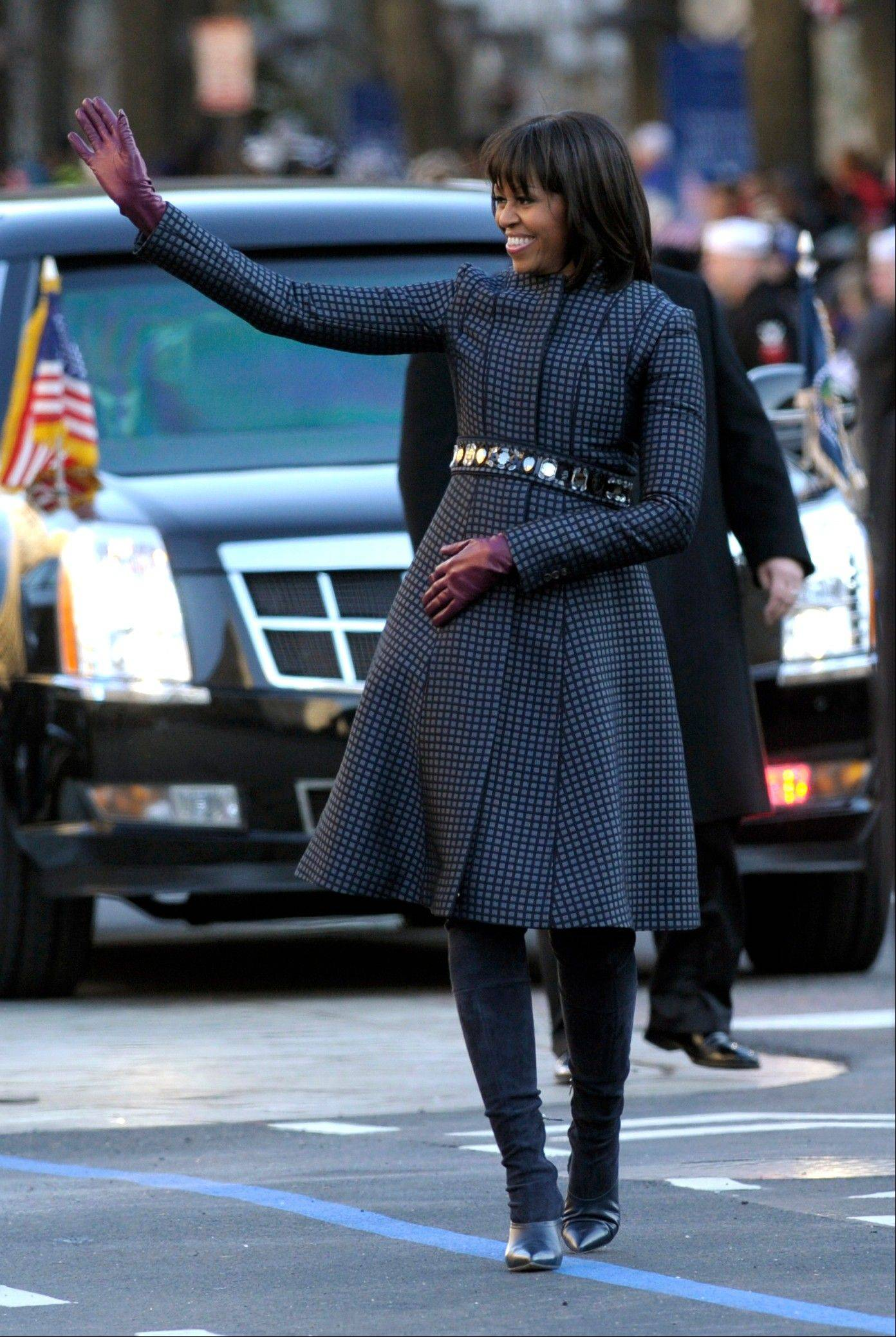 Associated Press file photo First lady Michelle Obama waves as she walks in the Inaugural Parade after the ceremonial swearing-in for the 57th Presidential Inauguration on Capitol Hill in Washington.