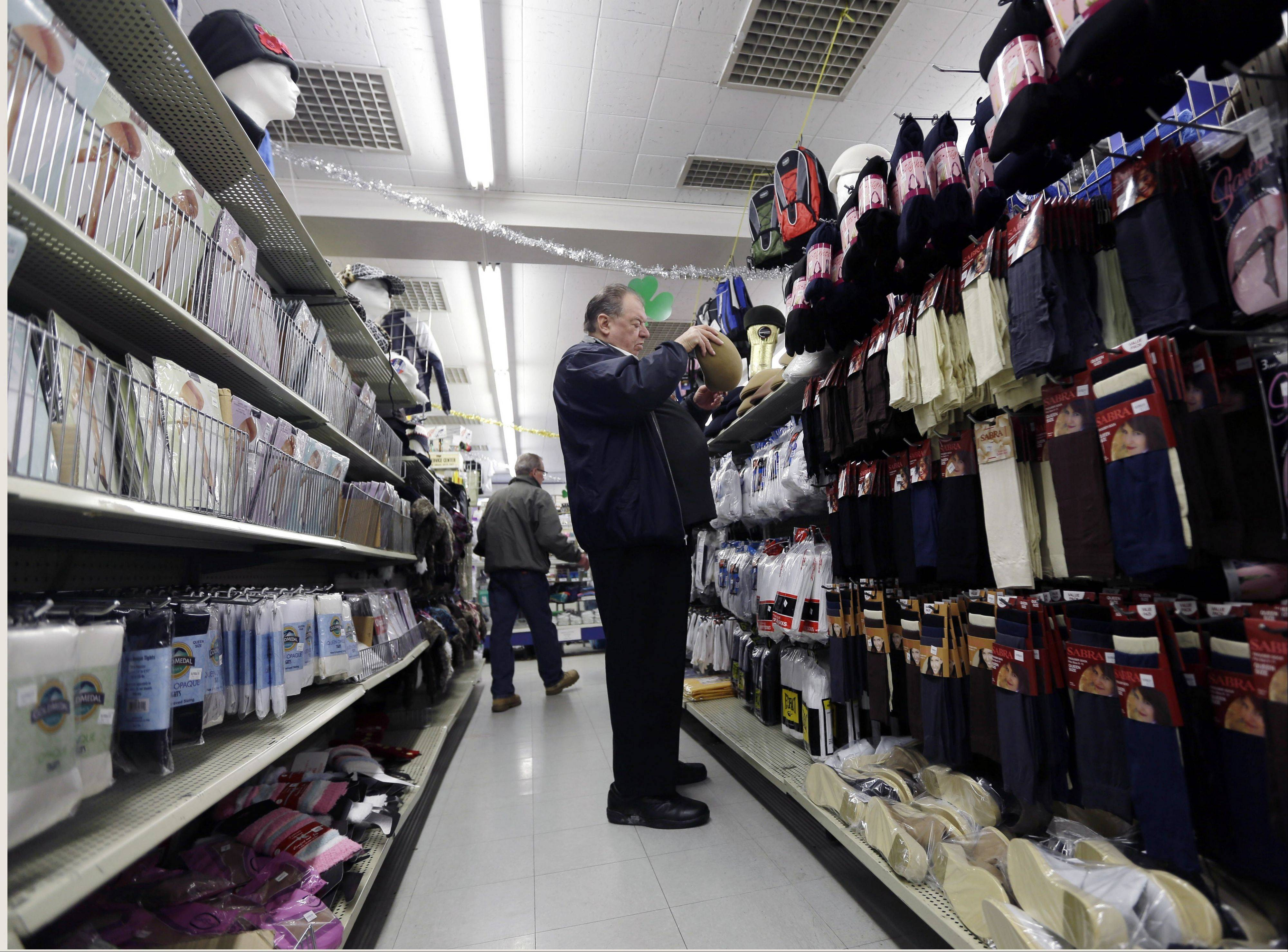 Marty Grossman shops for a hat at Lodge�s store on in Albany, N.Y. Americans spent at the fastest pace in five months in February, boosting retail spending 1.1 percent compared with January.