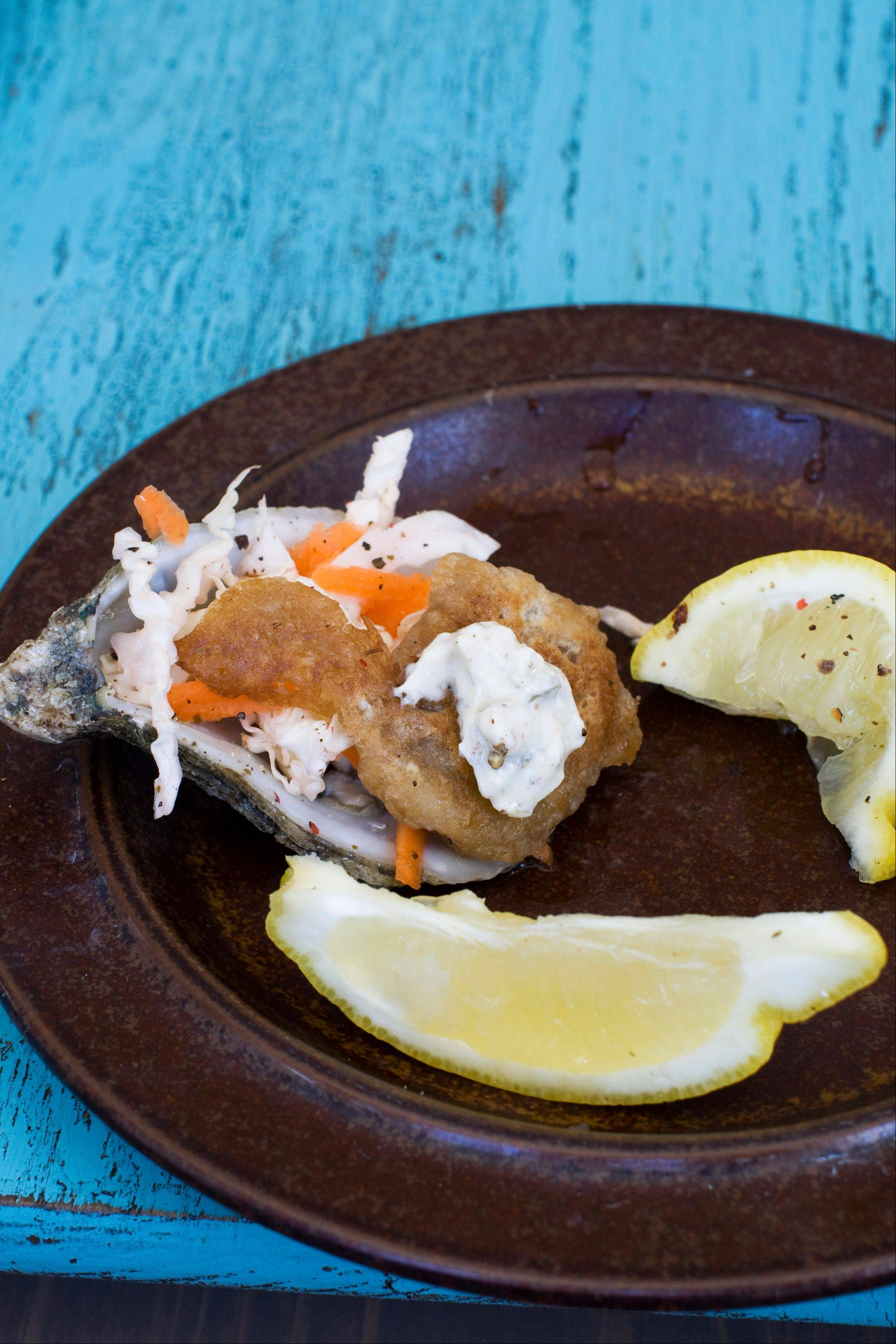 Guinness-battered oyster get a quick dip in hot oil before being served with mustard sauce.