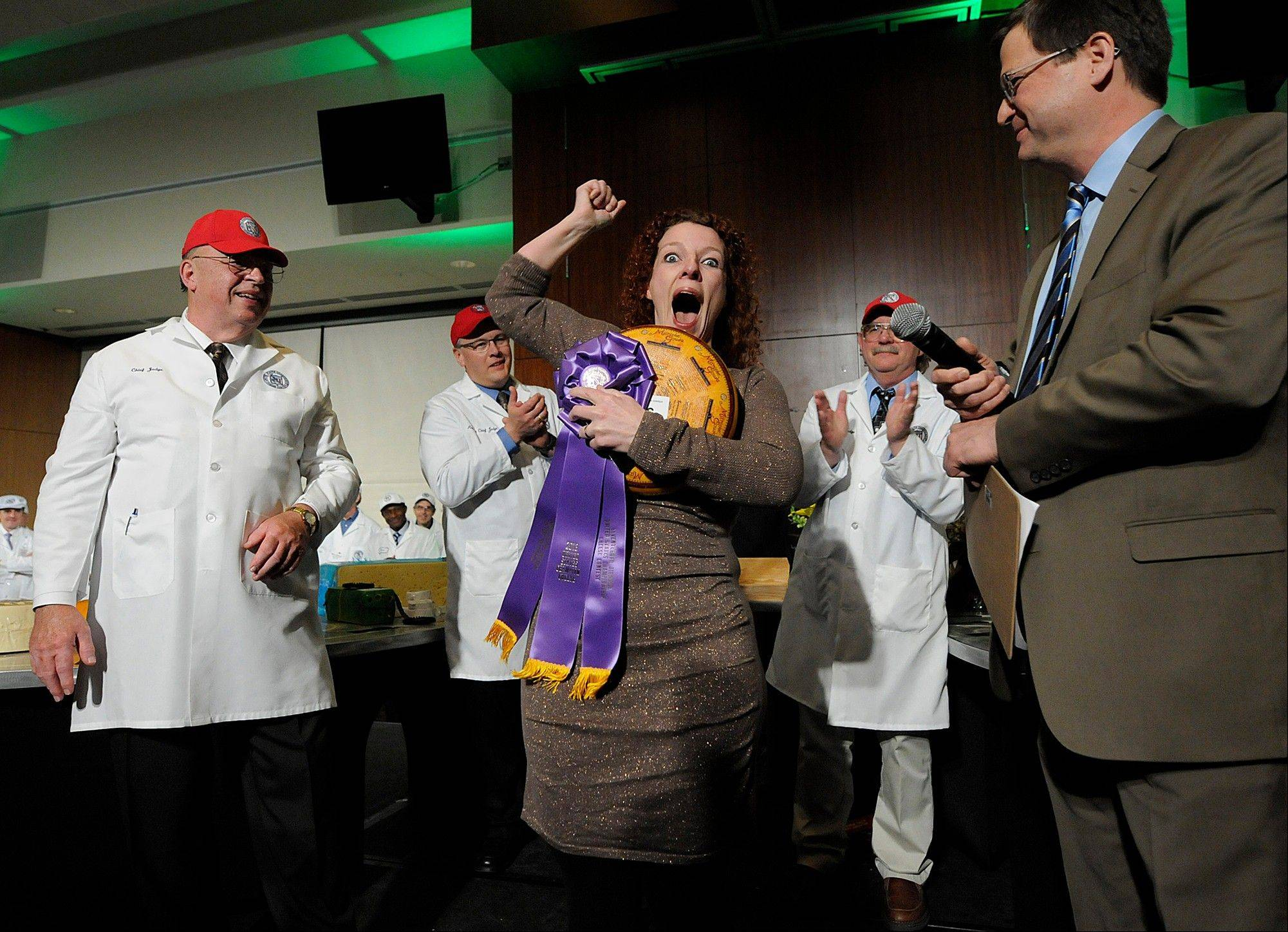 Marieke Penterman, owner of Holland's Family Cheese in Thorp, Wis., celebrates winning first place in the U.S. Cheese Championship Contest on Wednesday at Lambeau Field in Green Bay, Wis.