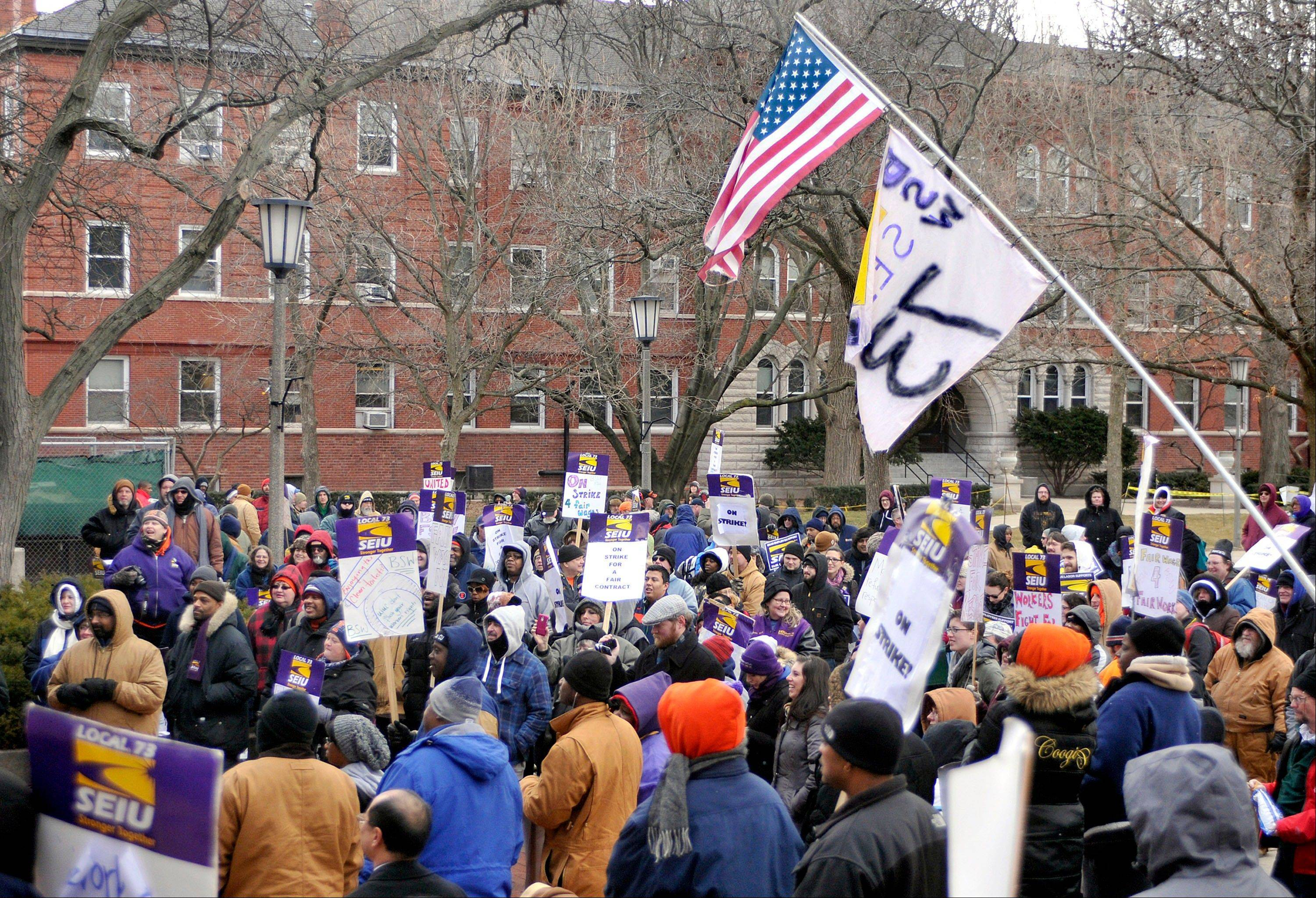 Members of Service Employees International Union Local 73 hold a rally on the University of Illinois Quad as their strike continues Wednesday in Urbana.